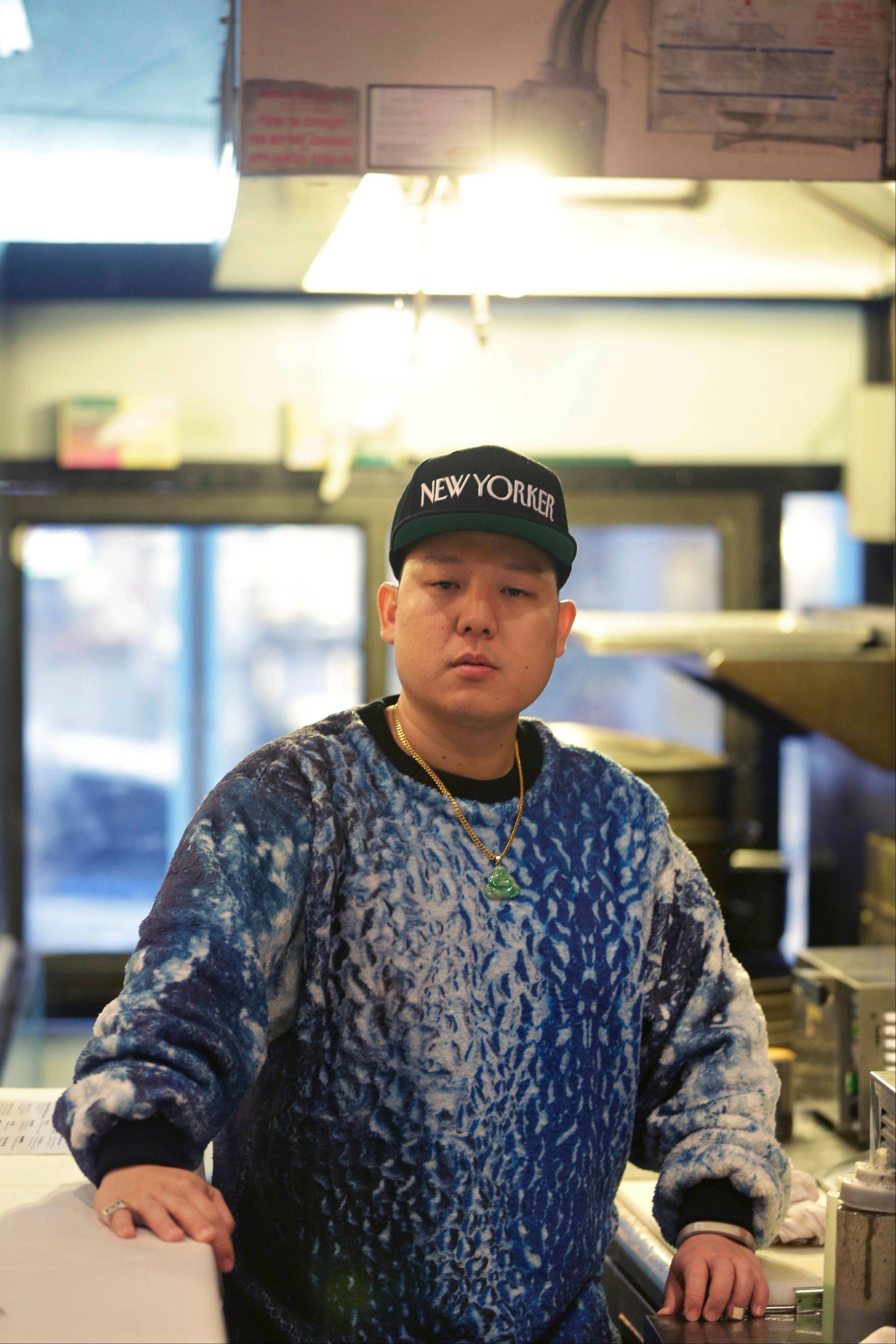 "Don't call him a celebrity chef. Eddie Huang, shown at his restaurant Baohaus in New York, also is the author of a biting new memoir, ""Fresh Off the Boat."""