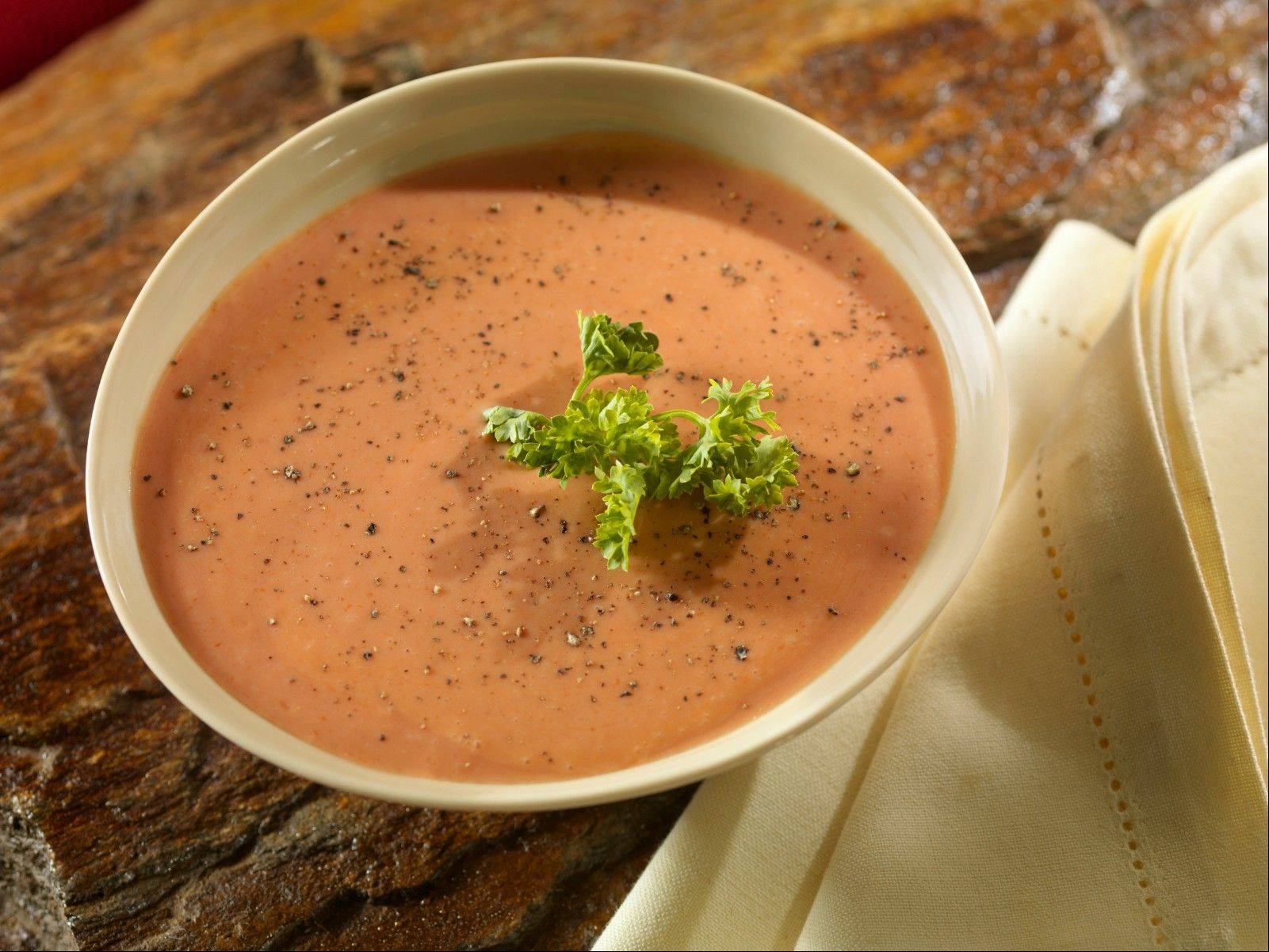The Artisan Table's menu includes this creamy tomato soup with fresh herbs.
