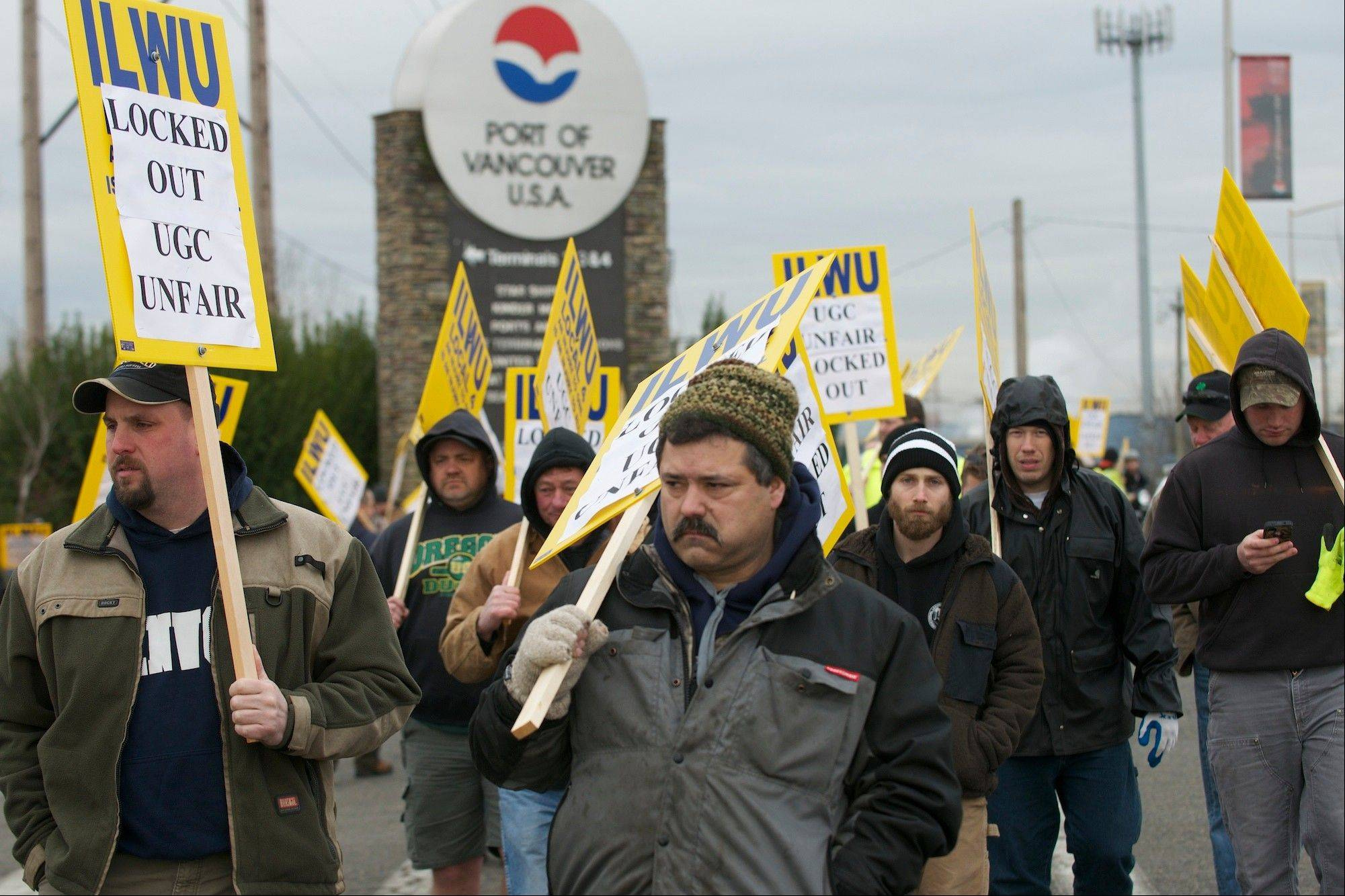 About 50 workers picket Wednesday outside the main entrance to the Port of Vancouver, in Vancouver, Wash.