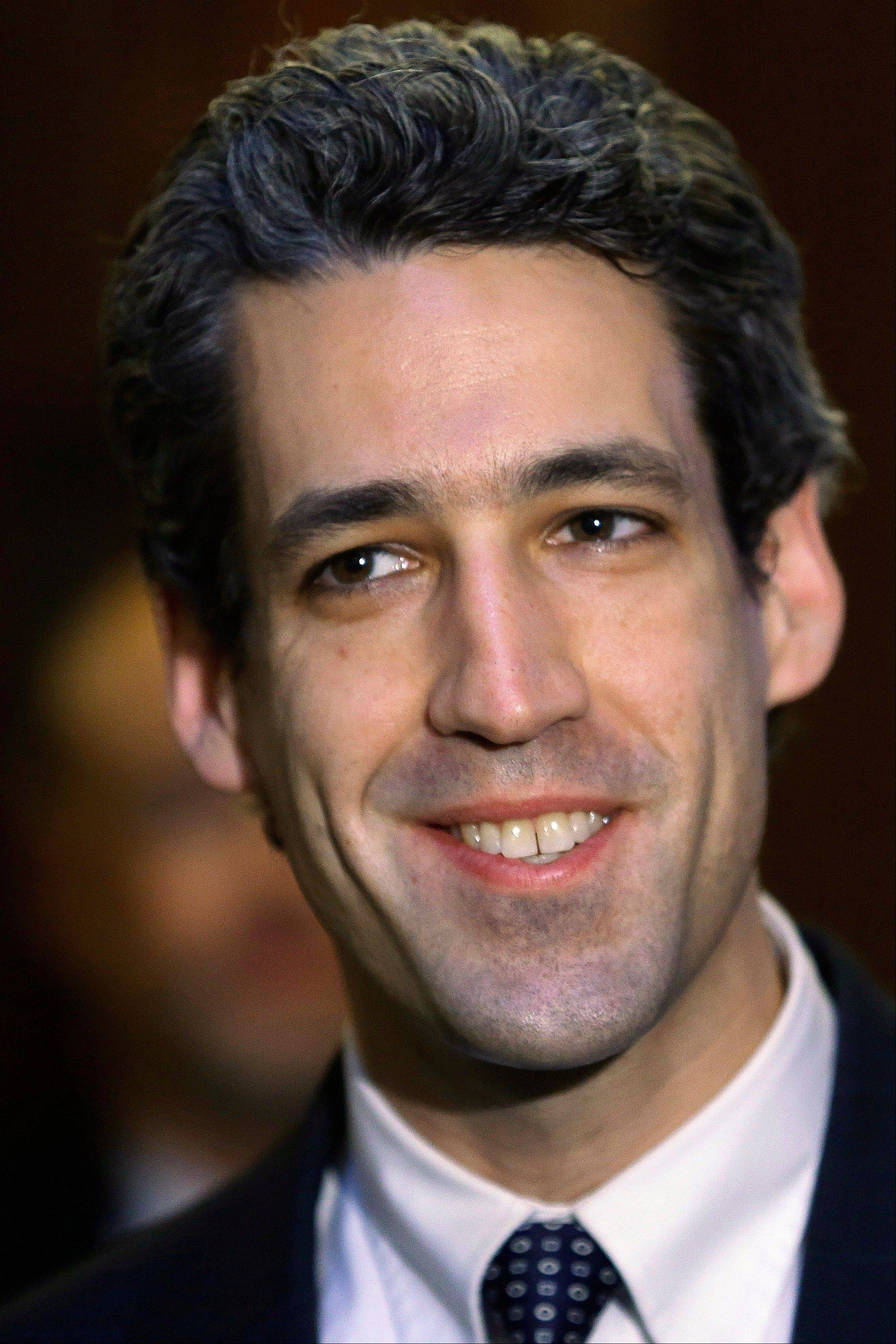 State Sen. Daniel Biss, an Evanston Democrat, speaks to reporters on pension legislation Wednesday in Springfield,