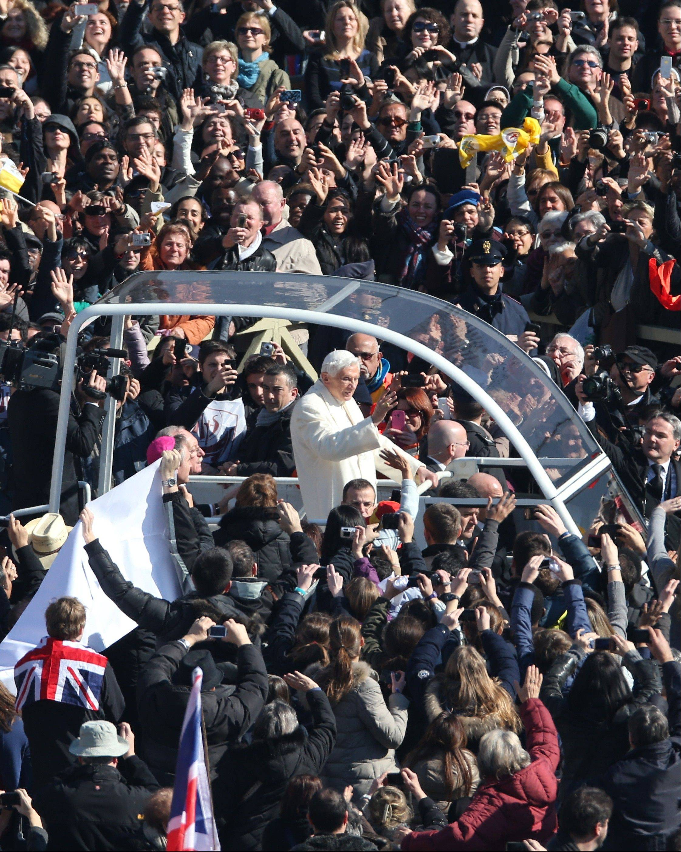 Pope Benedict XVI greets pilgrims in St. Peter's Square at the Vatican, Wednesday, Feb. 27, 2013 for the final time before retiring, waving to tens of thousands of people who have gathered to bid him farewell Benedict was driven around the square in an open-sided vehicle, surrounded by bodyguards.