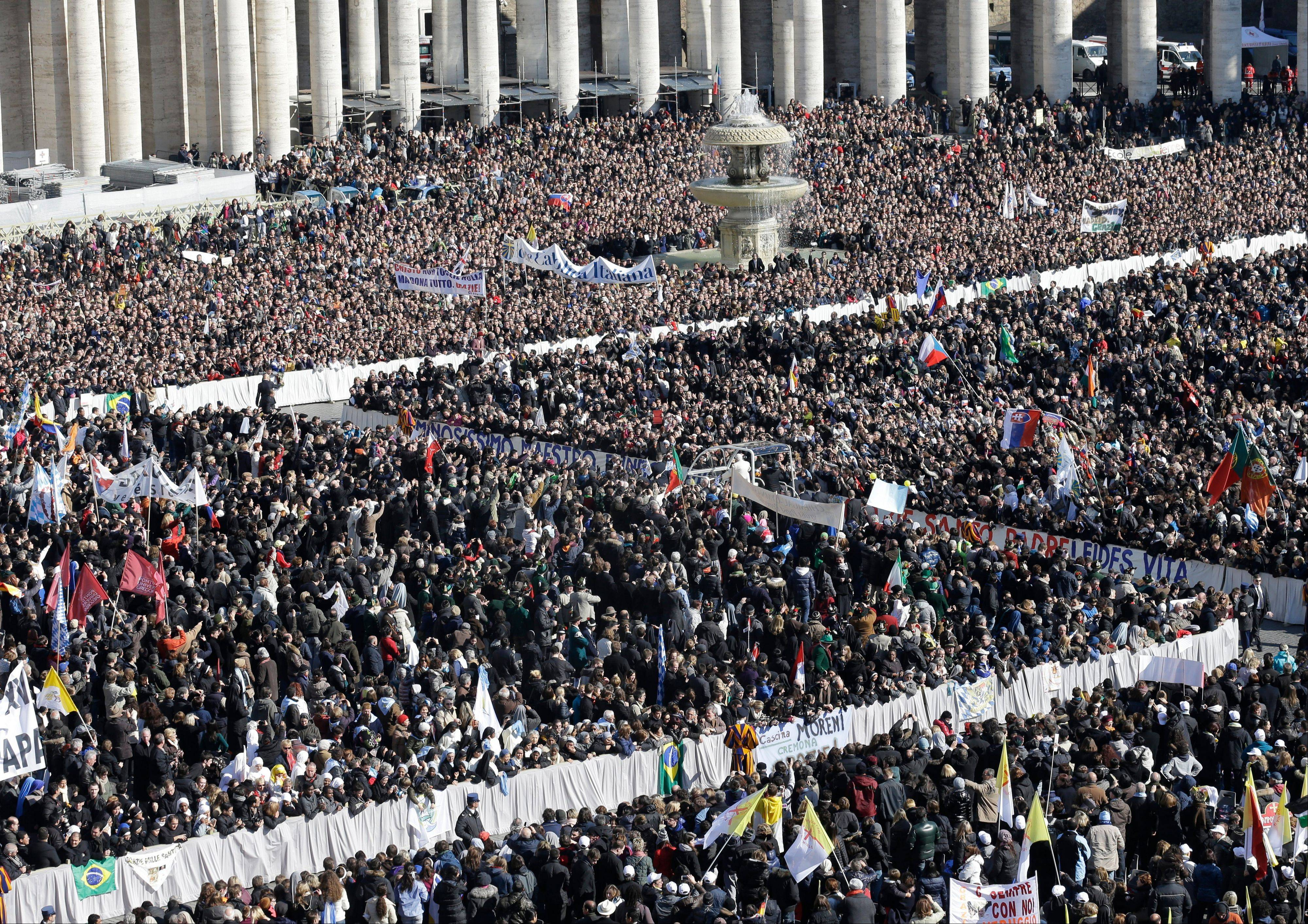 Pope Benedict XVI is driven through the crowd as he greets pilgrims in St. Peter's Square at the Vatican, Wednesday, Feb. 27, 2013 for the final time before retiring, waving to tens of thousands of people who have gathered to bid him farewell.