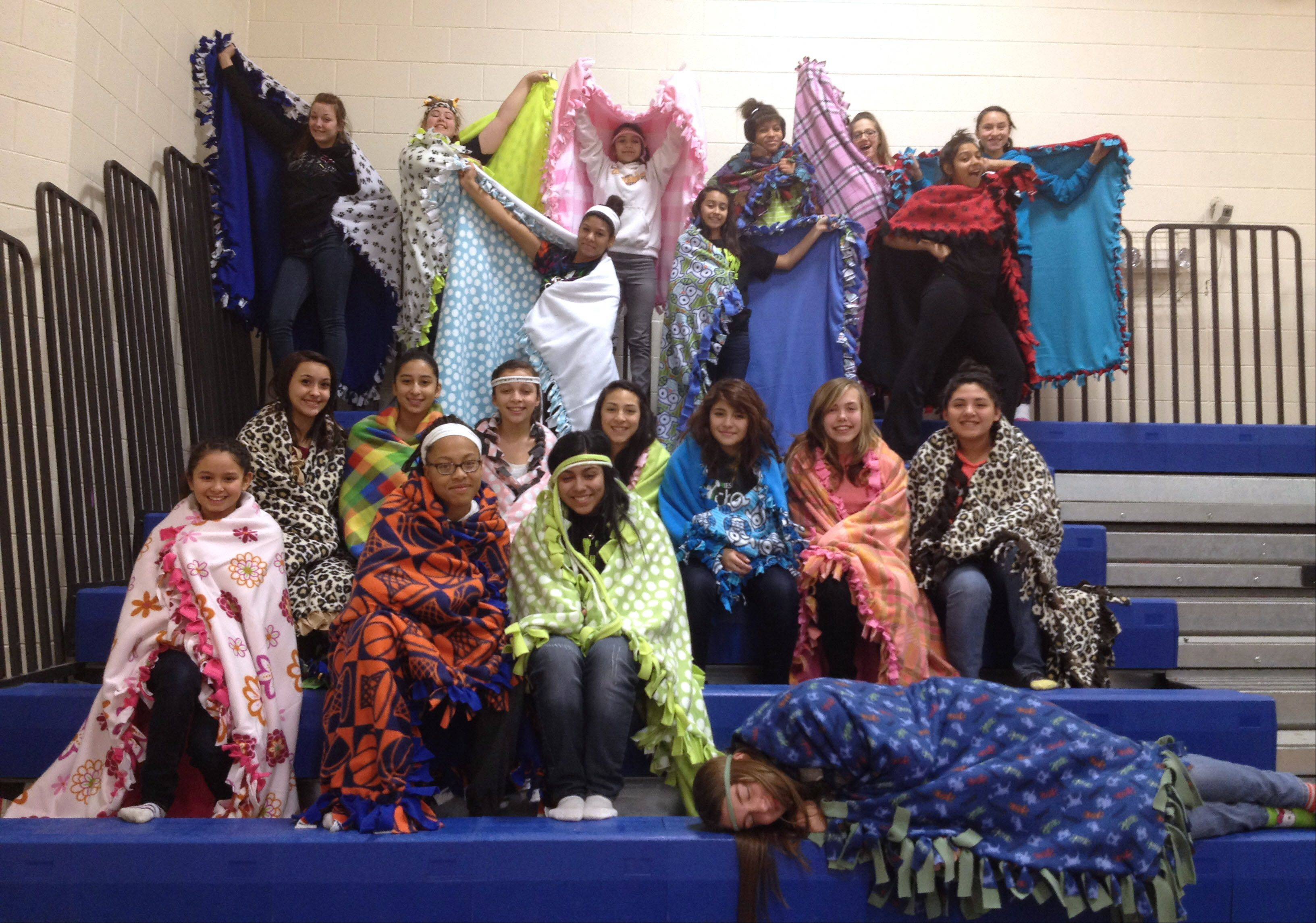The Wildcat cheerleaders at Round Lake Middle School made fleece blankets that they donated to the Staben Center and Staben House, both in Waukegan.