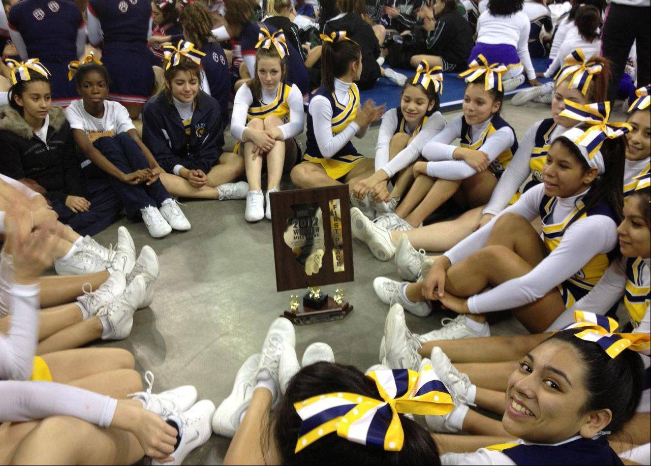 The Wildcat cheerleaders took first place in the Large Cheer Division at Schaumburg High School/Conant High School Winter Melt Down at the Sears Centre, sponsored by both the IHSA schools and the Illinois Recreational Cheer Association.