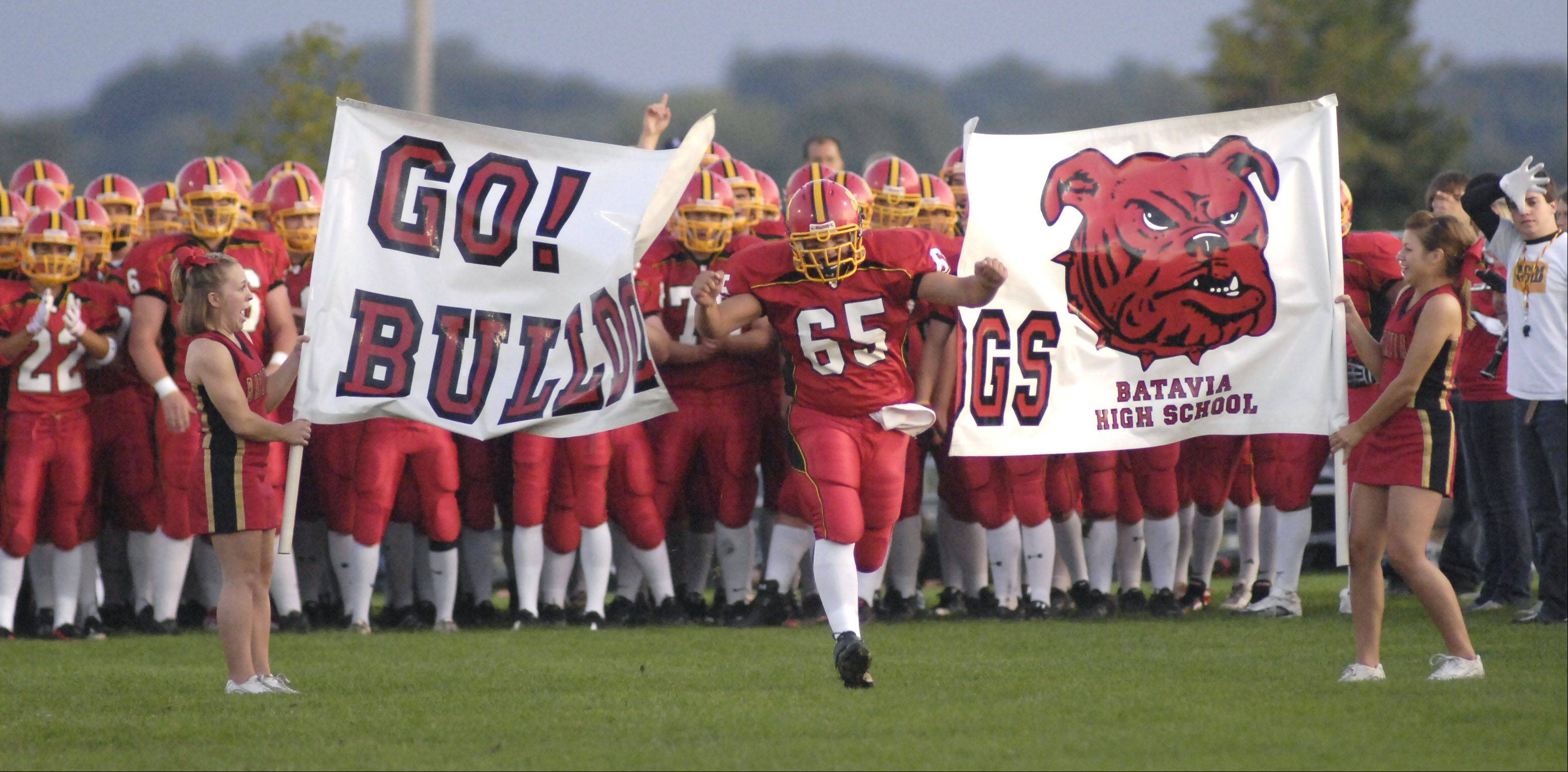 LAURA STOECKER/lstoecker@dailyherald.com, 2009Batavia High School's Sean Tews takes to the field for a 2009 home game. A plan has been outlined for improving the athletics fields at Batavia High School, including installing artificial turf.
