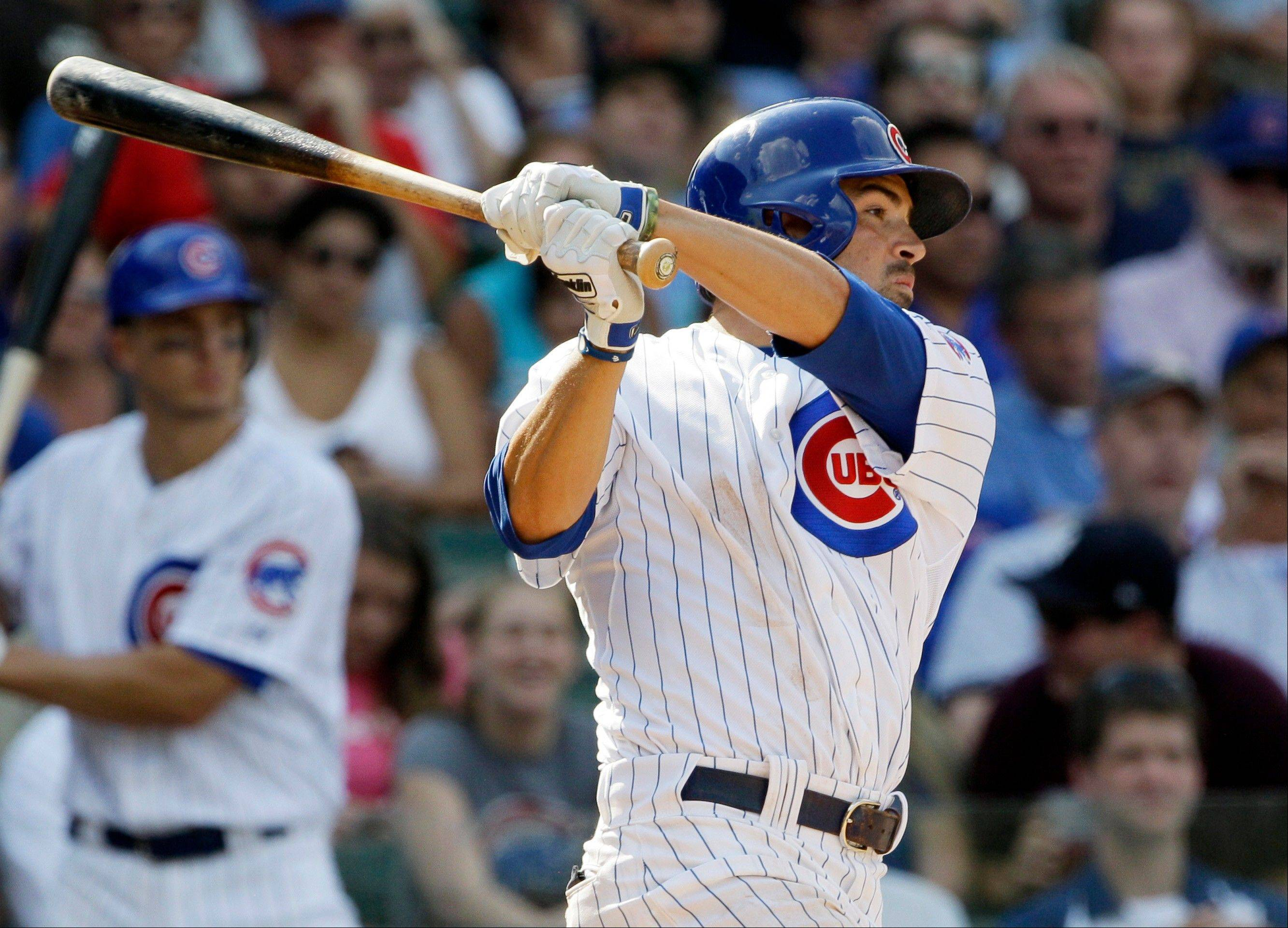Chicago Cubs' David DeJesus hits a single against the Houston Astros during the eighth inning of a baseball game in Chicago, Wednesday, Aug. 15, 2012.