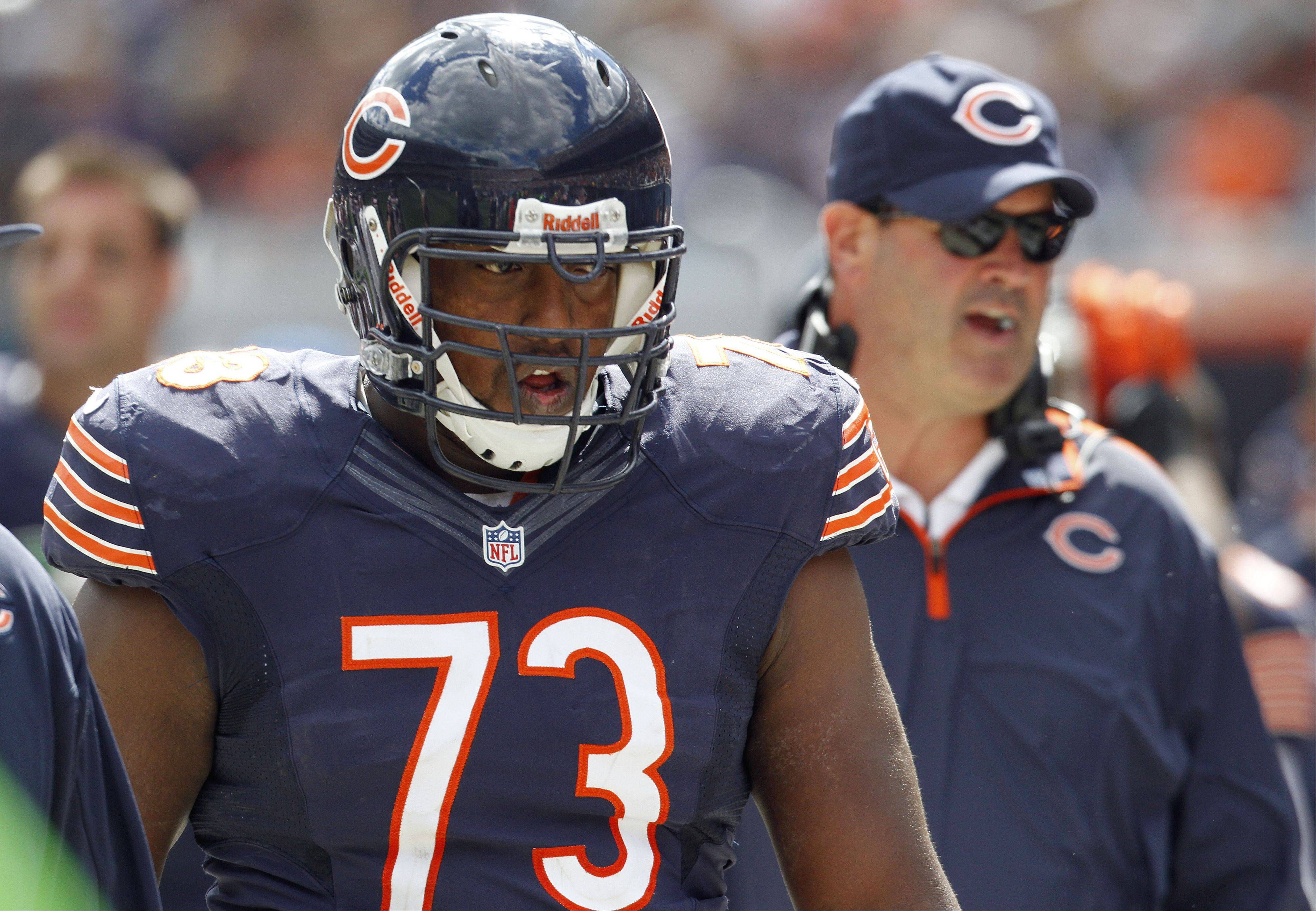 Steve Lundy/slundy@dailyherald.com � Chicago Bears tackle J'Marcus Webb walks to the bench with offensive coordinator Mike Tice following during the Bears 23-6 win over the St. Louis Rams Sunday at Soldier Field in Chicago.