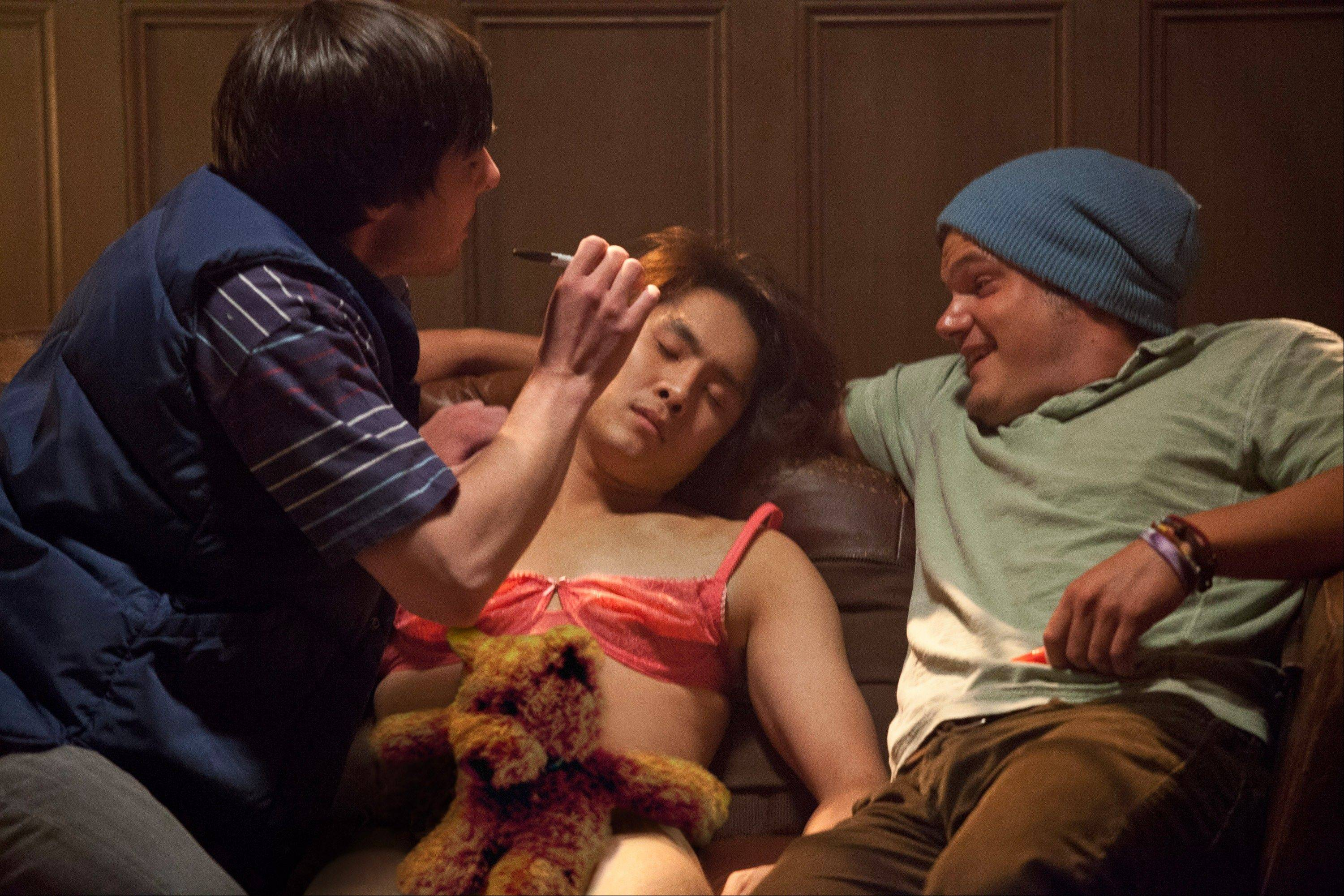 "Jeff Chang (Justin Chon), center, gets a full haze treatment on the night of his 21st birthday in the ribald college comedy ""21 and Over."""