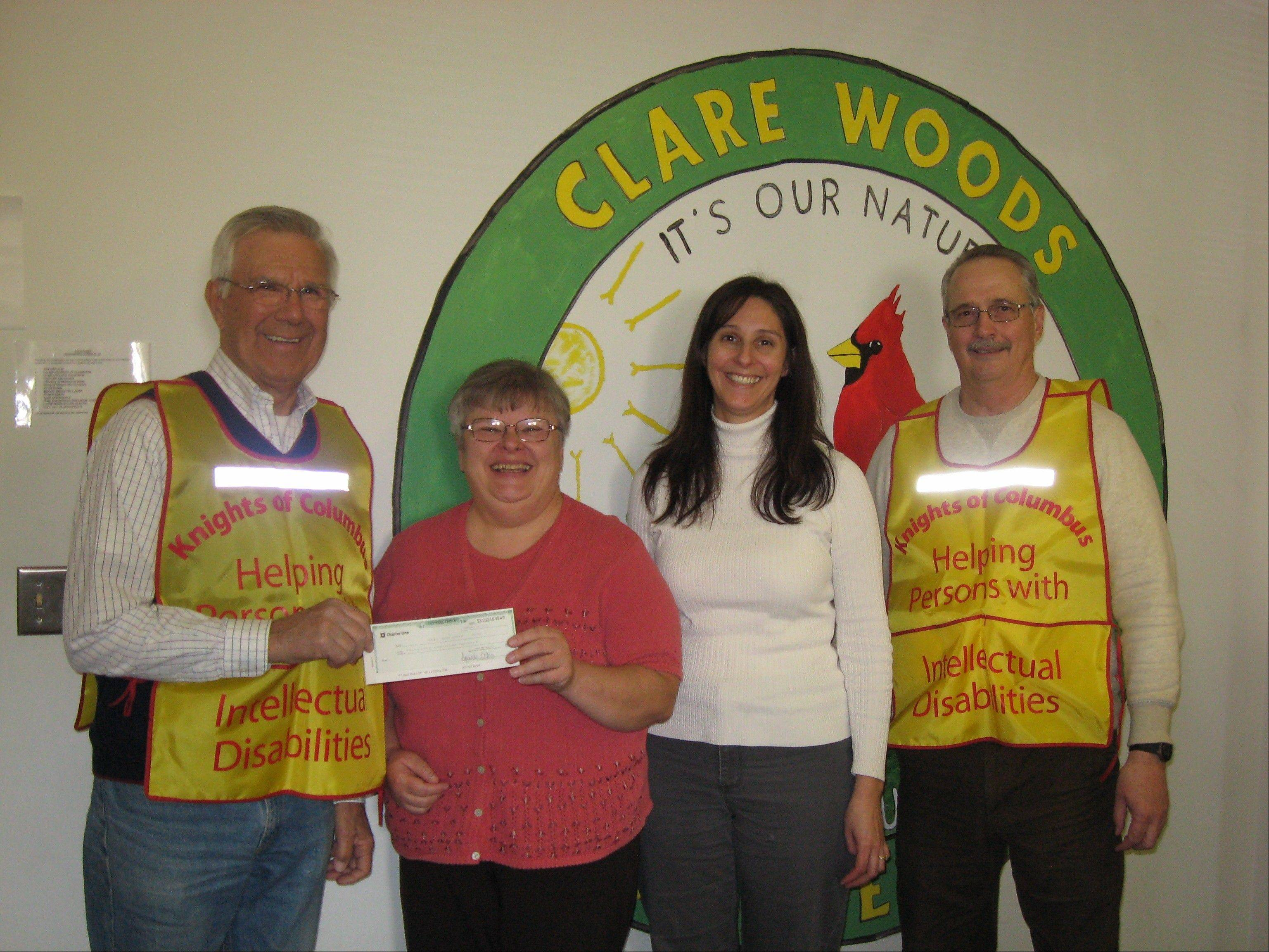 A local chapter of the Knights of Columbus recently donated $1,000 to the Bartlett Learning Center that will be put toward purchasing a new vehicle that can transport residents in a group home. Pictured, from left to right, are John Warwick, Knights of Columbus recording secretary; Linda Frye-Danner, Bartlett Learning Center development director; Elaina McCalmont, Bartlett Learning Center development administration assistant; and Skip Cordell, Knights of Columbus Council Warden.