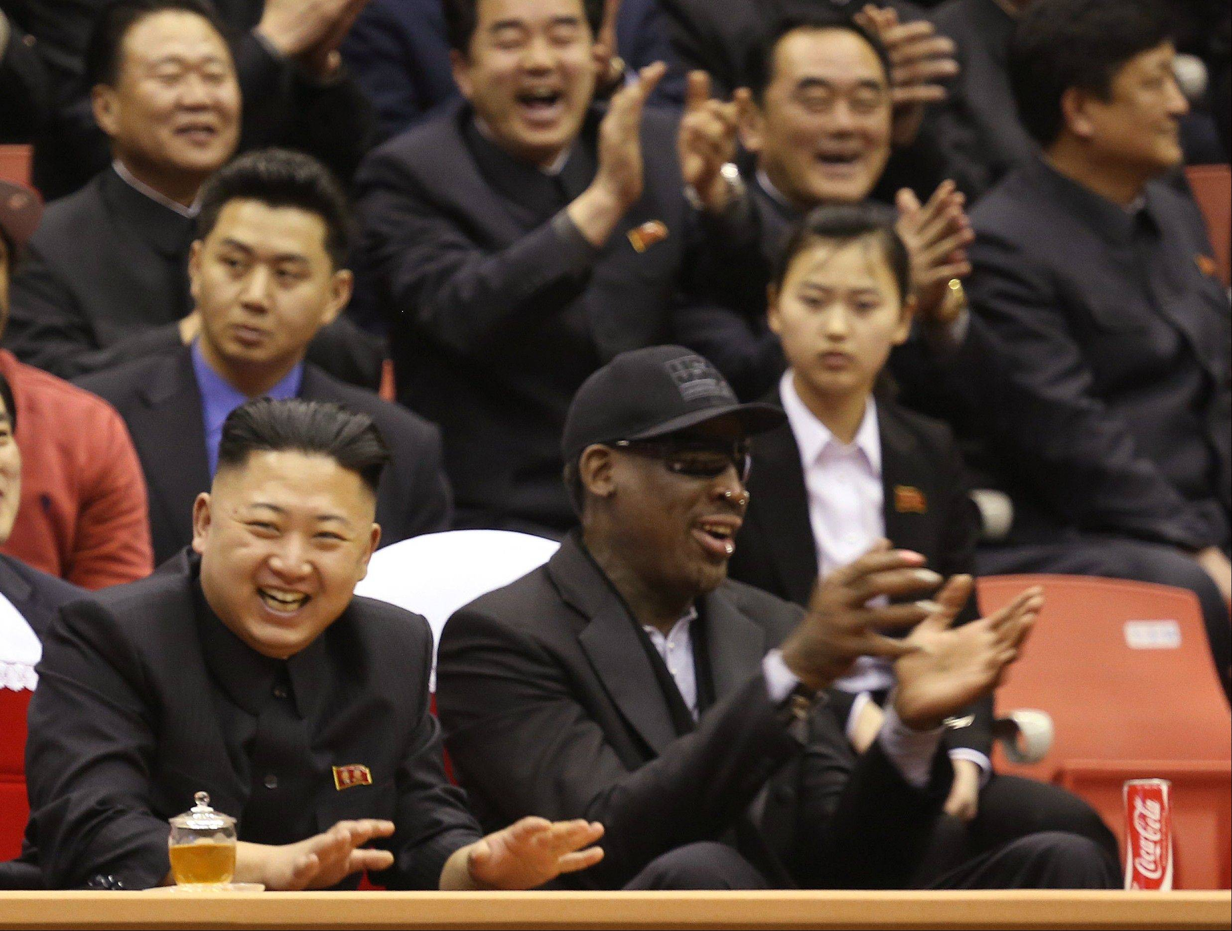 ASSOCIATED PRESS North Korean leader Kim Jong Un, left, and former NBA star Dennis Rodman watch North Korean and U.S. players in an exhibition basketball game at an arena in Pyongyang, North Korea, Thursday. Rodman arrived in Pyongyang on Monday with three members of the Harlem Globetrotters basketball team to shoot an episode on North Korea for a new weekly HBO series.