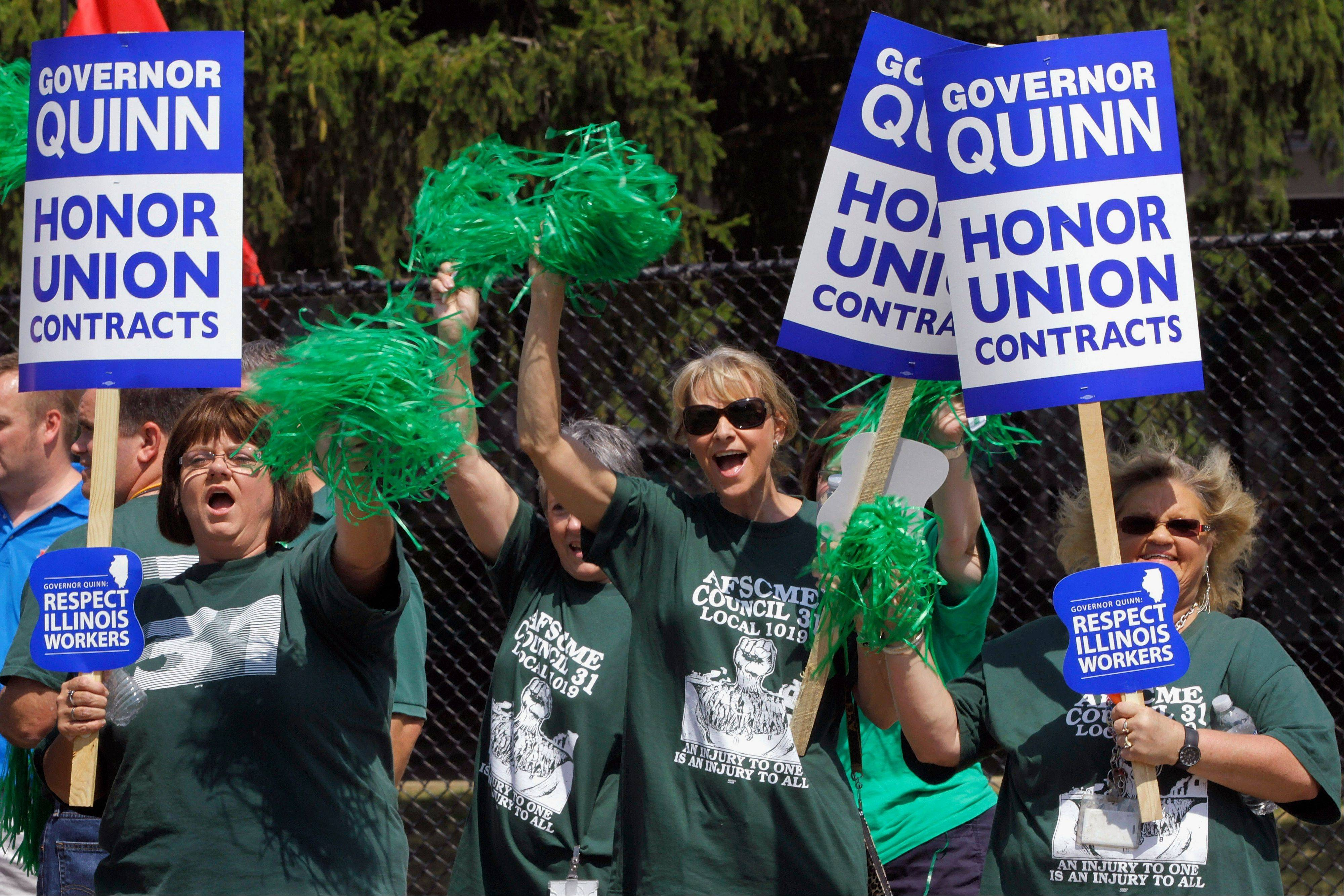 Union members, supporters and labor leaders protest against Illinois Gov. Pat Quinn at the state fair in Springfield. On Thursday, Quinn�s office confirmed that the largest state employee union in Illinois and his administration have reached a tentative contract agreement. Negotiations between the American Federation of State, County and Municipal Employees union and Quinn�s office have been contentious and union members had started preparing for a strike.
