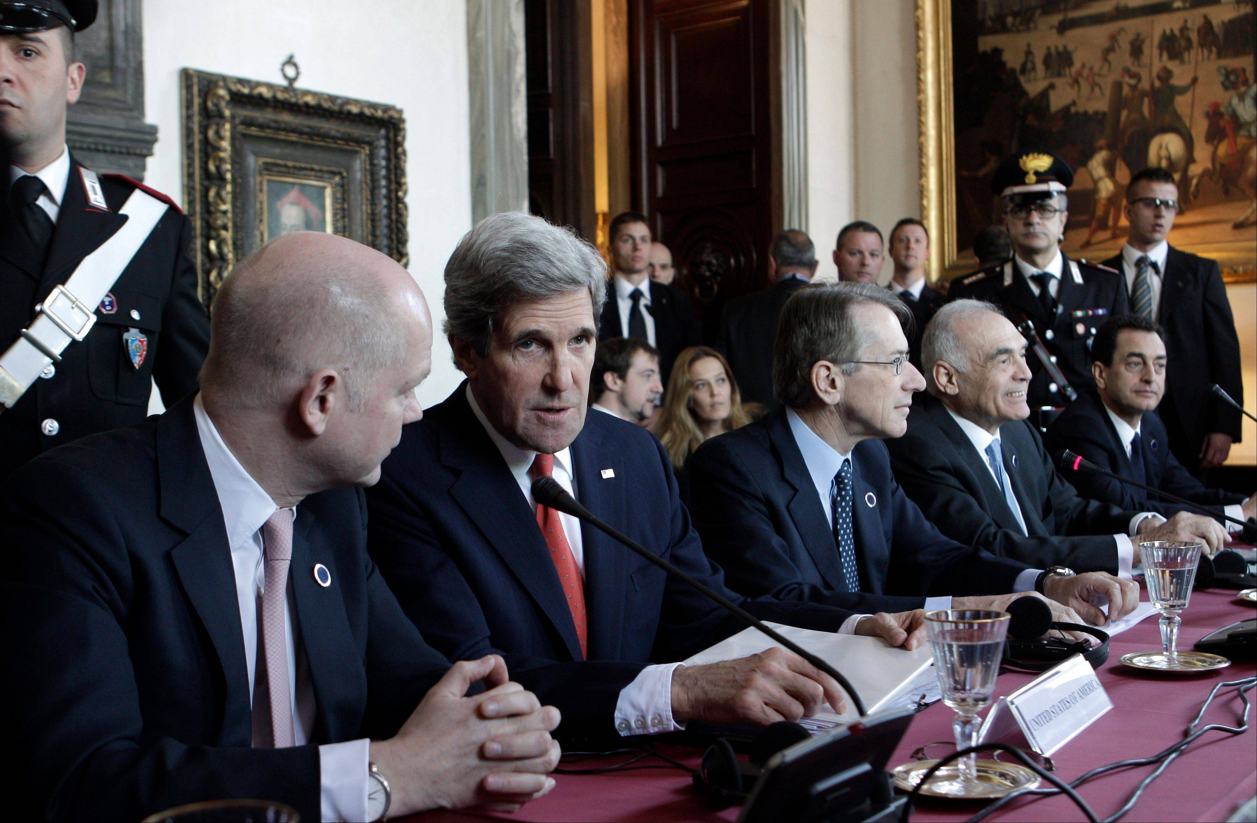 U.S. secretary of state John Kerry, second from left, talks to British Prime Minister William Hague, left, as Italian Foreign Minister Giulio Terzi, third from left, and Egyptian Foreign Minister Mohamed Kamel Amr, second from right, are seen Thursday during an international conference on Syria at Villa Madama, Rome. The United States is looking for more tangible ways to support Syria�s rebels and bolster a fledgling political movement that is struggling to deliver basic services after nearly two years of civil war, Kerry said Wednesday. In the background at left is British Foreign Secretary William Hague.