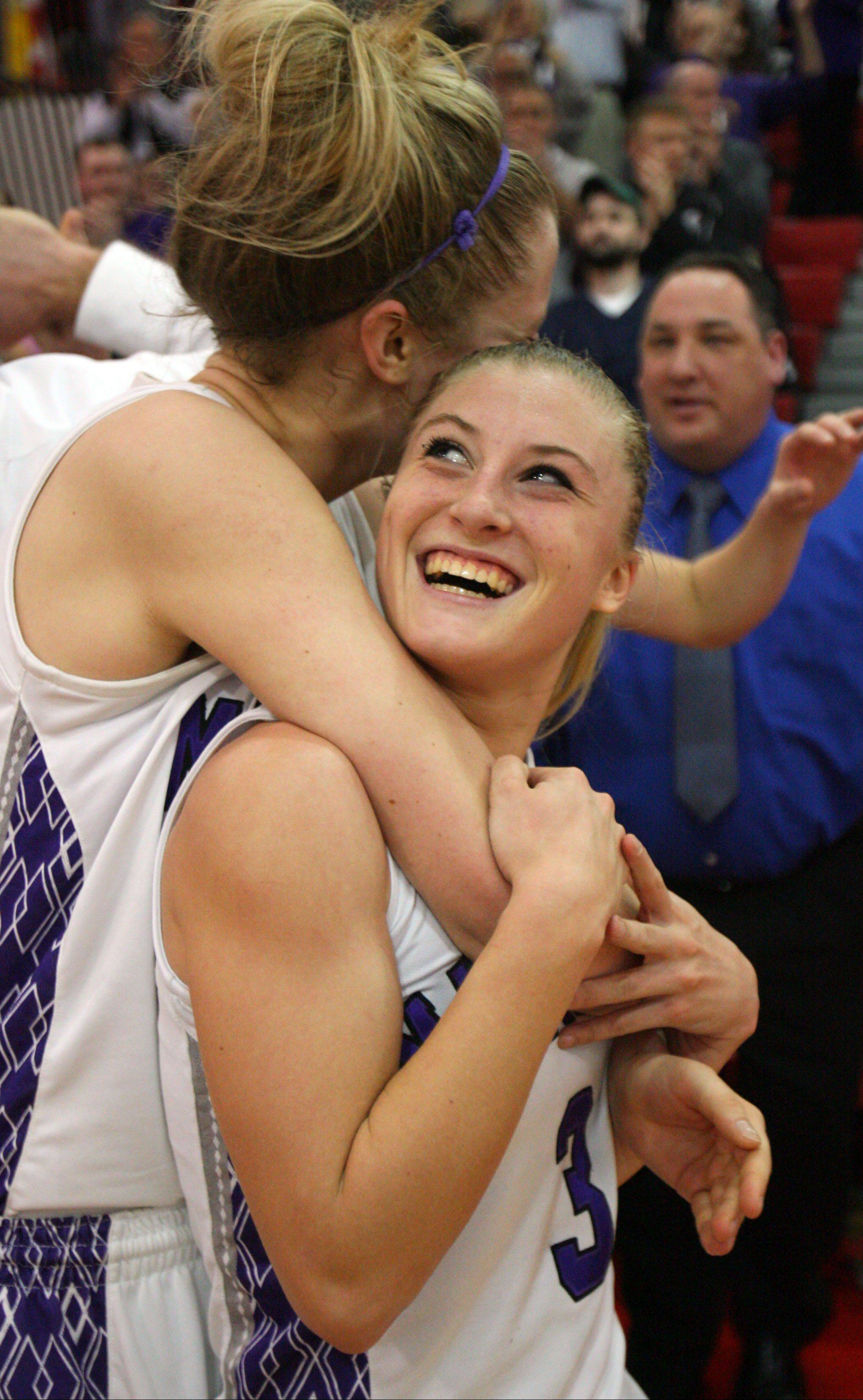 Rolling Meadows' Jenny Vliet, left, and Jackie Kemph embrace after topping Evanston in Monday's Niles West supersectional. The Mustangs face Huntley in a Class 4A state semifinal at 6:30 p.m. Friday.