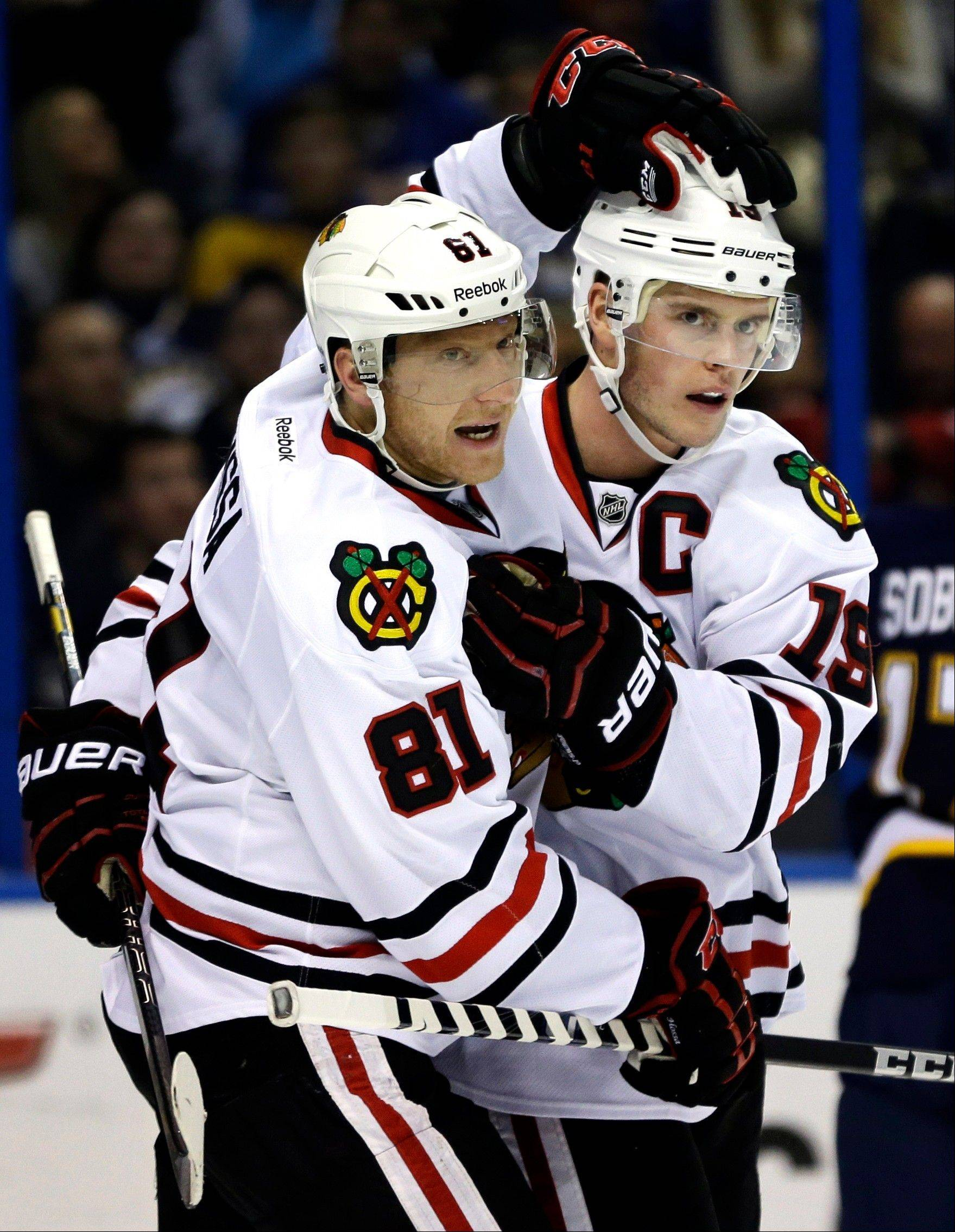 Chicago Blackhawks' Jonathan Toews, right, is congratulated by Marian Hossa, of Slovakia, after Toews scored his second goal of an NHL hockey game during the third period against the St. Louis Blues, Thursday, Feb. 28, 2013, in St. Louis. The Blackhawks won 3-0. (AP Photo/Jeff Roberson)