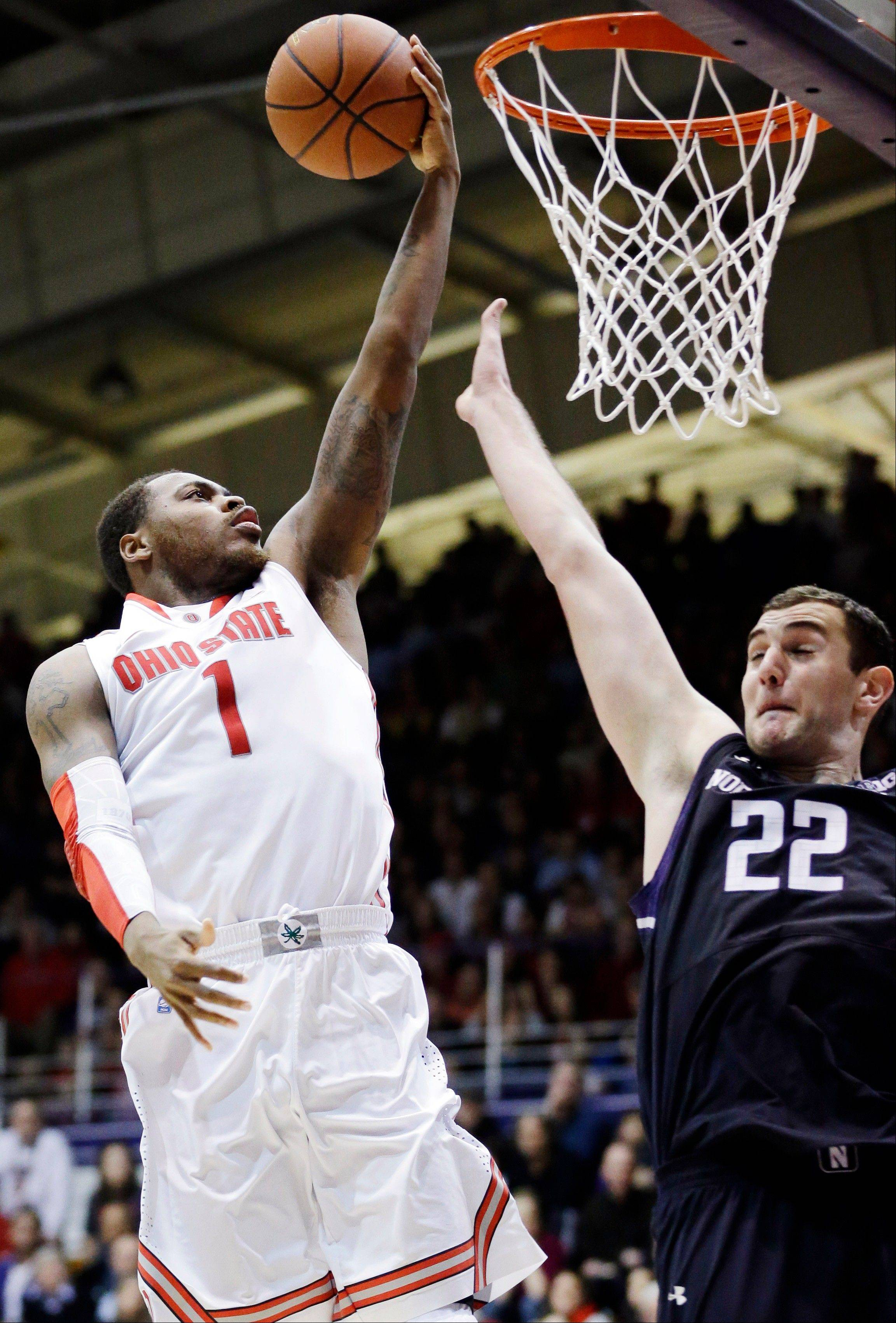 Ohio State forward DeShaun Thomas (1) drives to the basket against Northwestern center Alex Olah during the second half of an NCAA college basketball game in Evanston, Ill., Thursday, Feb. 28, 2013. Ohio State won 63-53. (AP Photo/Nam Y. Huh)