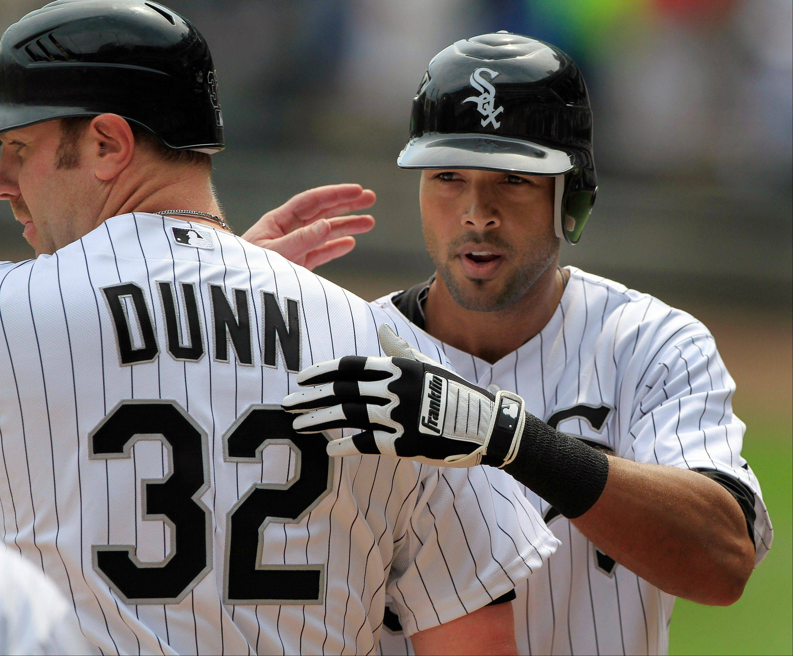 Chicago White Sox's Alex Rios, right, congratulated by teammate Adam Dunn after hitting a grand slam against the Minnesota Twins during the first inning of a baseball game, Wednesday, Sept. 5, 2012, in Chicago. (AP Photo/John Smierciak)