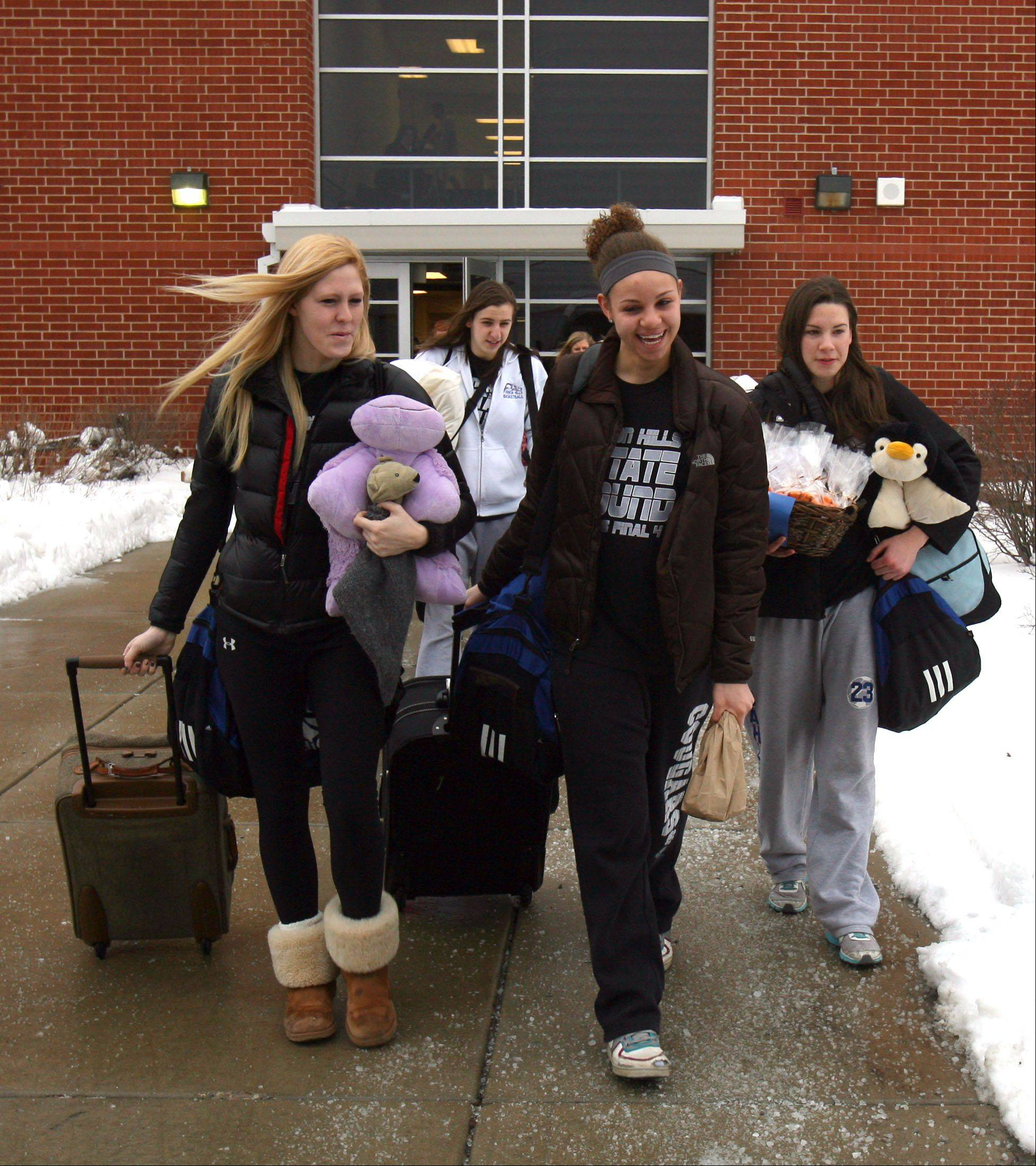 The Vernon Hills High School�s girls basketball team heads to the bus that will take them to the Class 3A girls state basketball tournament at Redbird Arena in Normal this weekend.