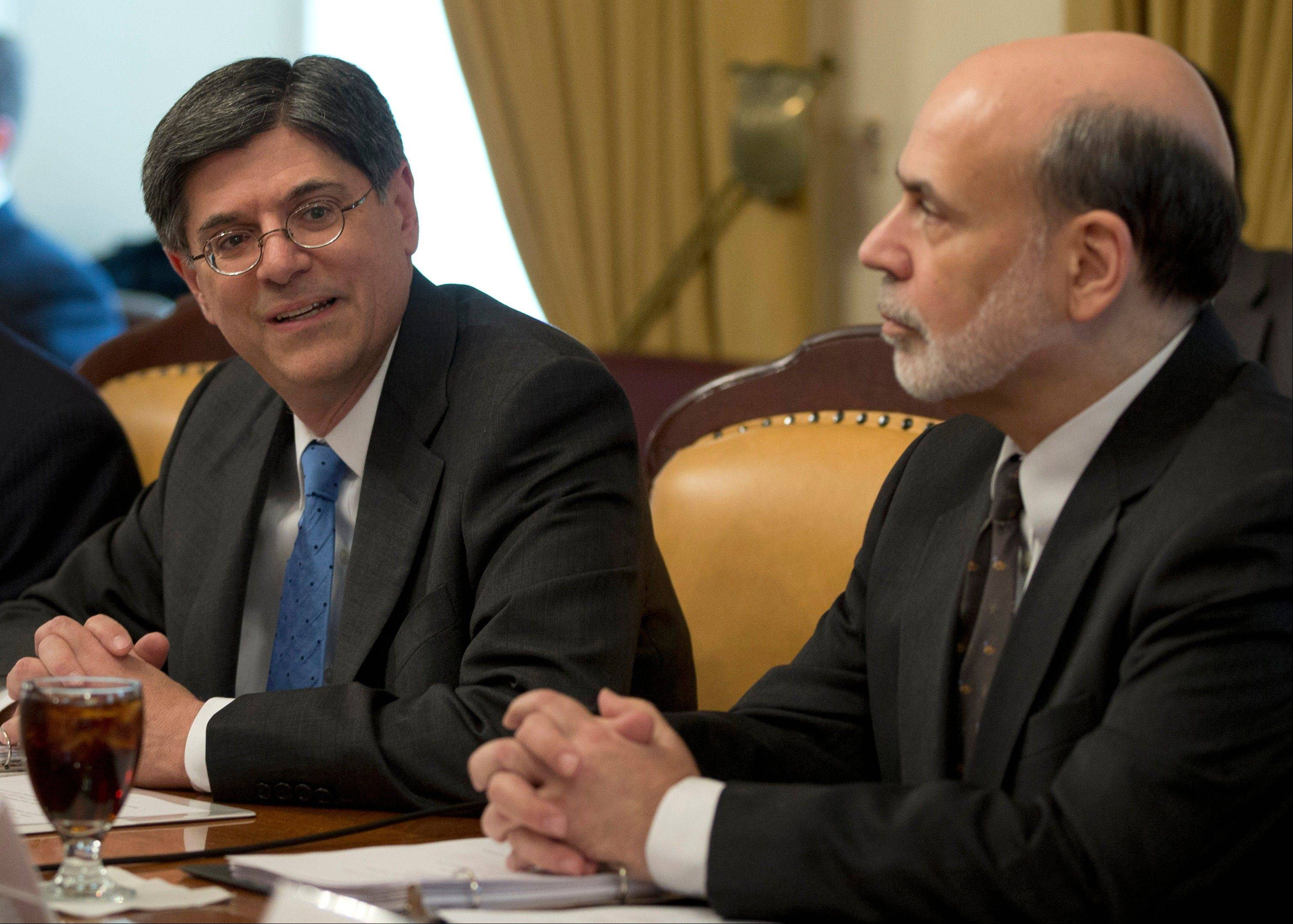 Treasury Secretary Jack Lew, left, accompanied by Federal Reserve Chairman Ben Bernanke, speaks to reporters before his first meeting as Treasury secretary Thursday.
