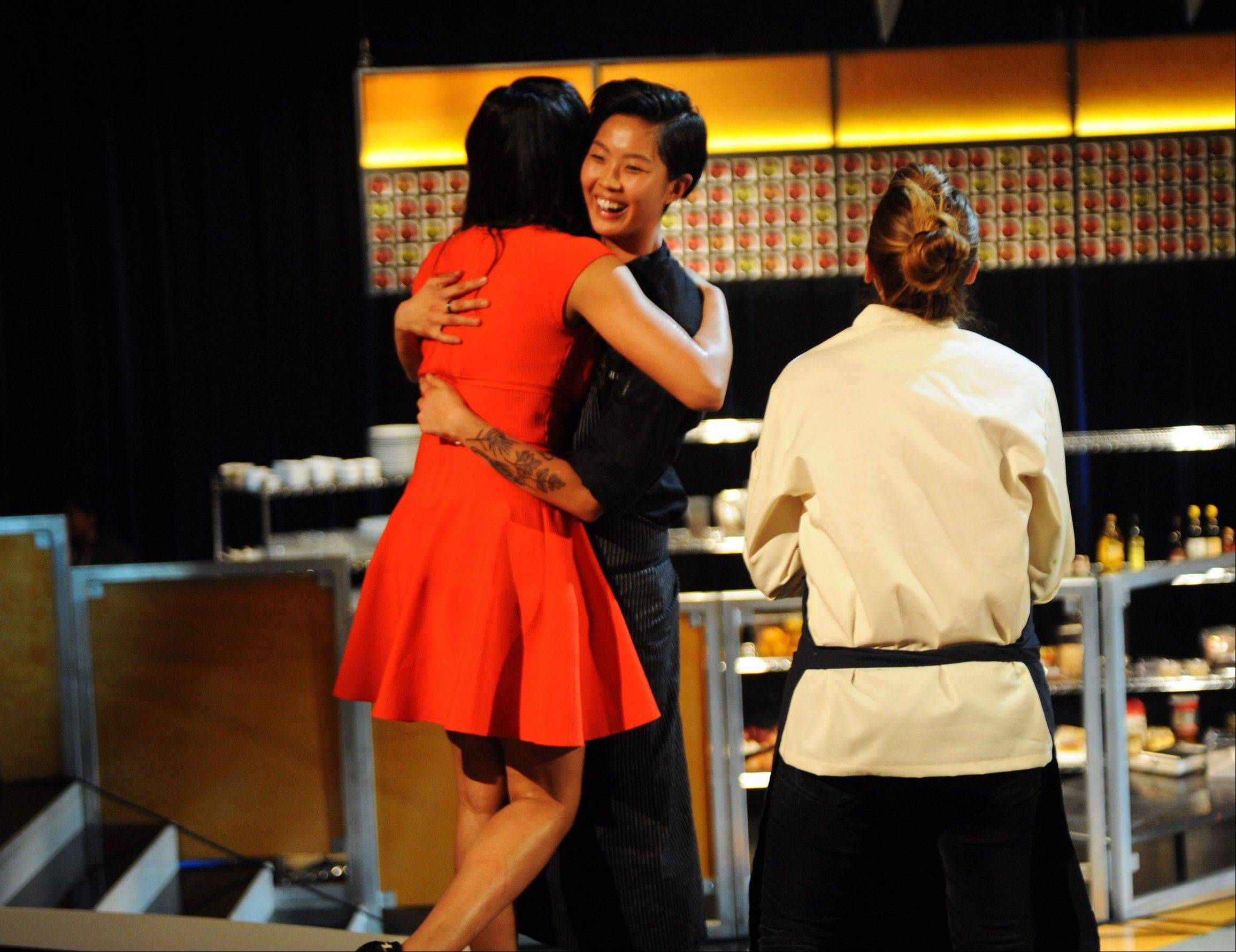 "Judge Padma Lakshmi, left, embraces ""Top Chef: Seattle"" winner Kristen Kish, center, while contestant Brooke Williamson looks on during the show's finale that aired Wednesday."