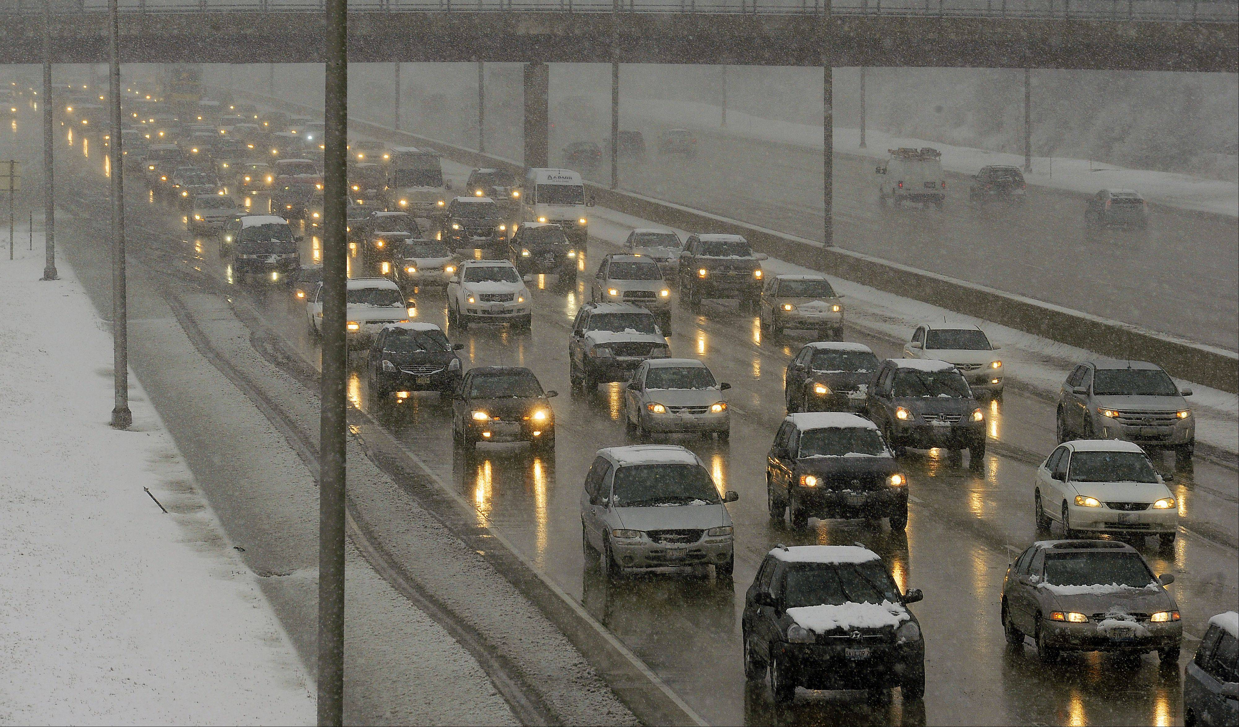 Tuesday's snow didn't stop cars from moving along I-290, where commuting times weren't as bad as expected.