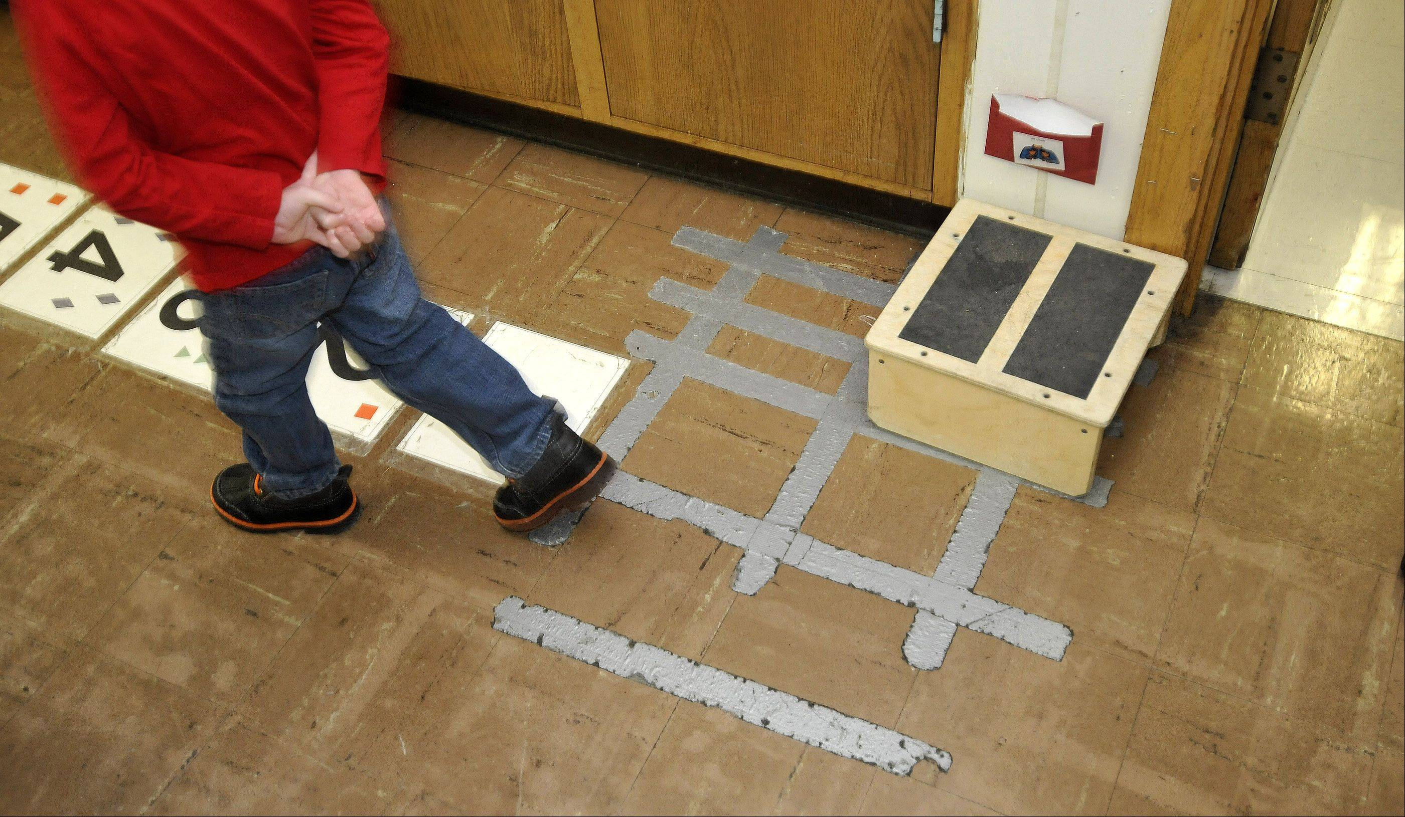 Floor tiles in one of Jefferson Early Childhood Center's classrooms need to be held down with duct tape.