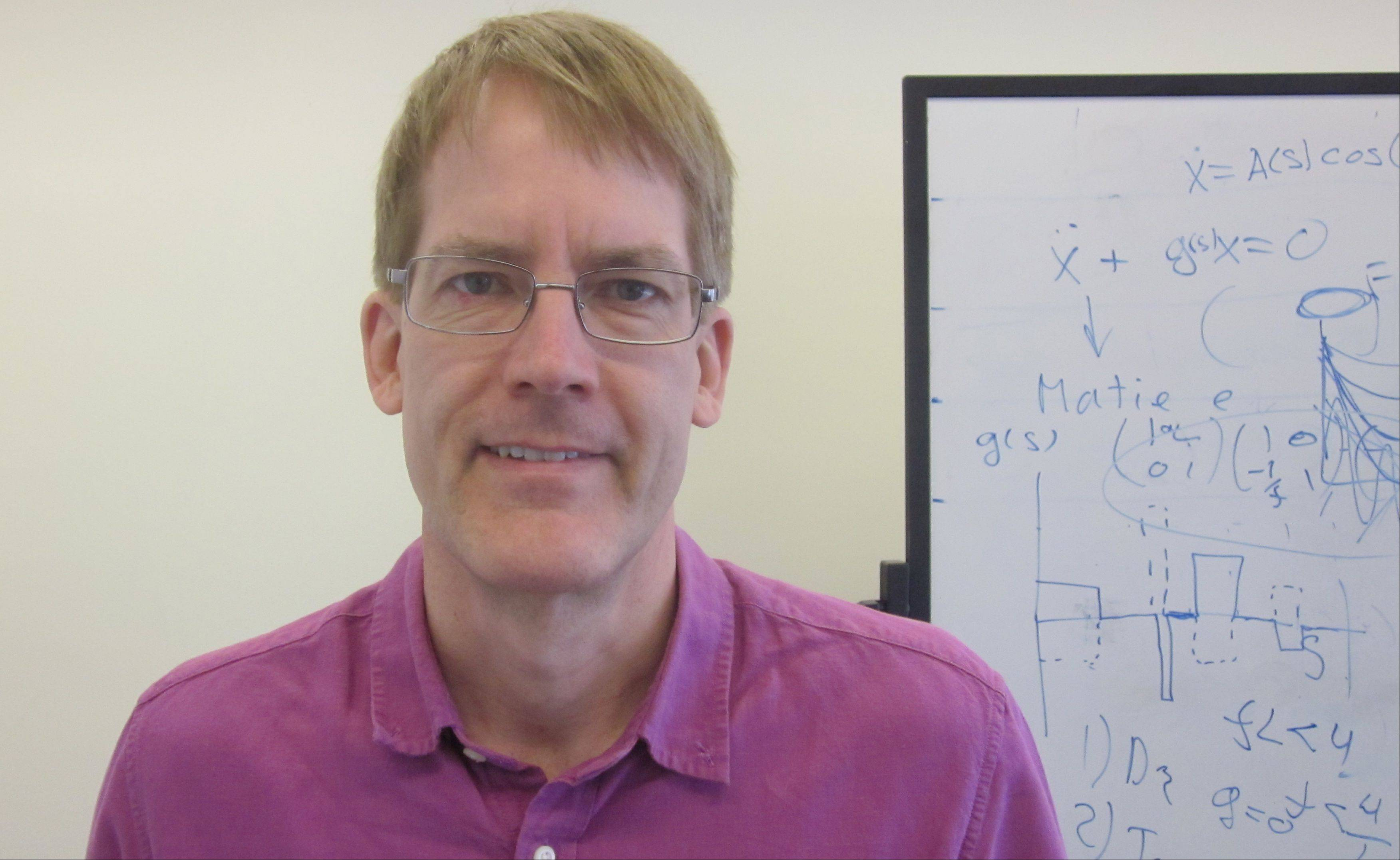 Dr. Joe Lykken of Wheaton, is particle physics theorist at Fermilab.