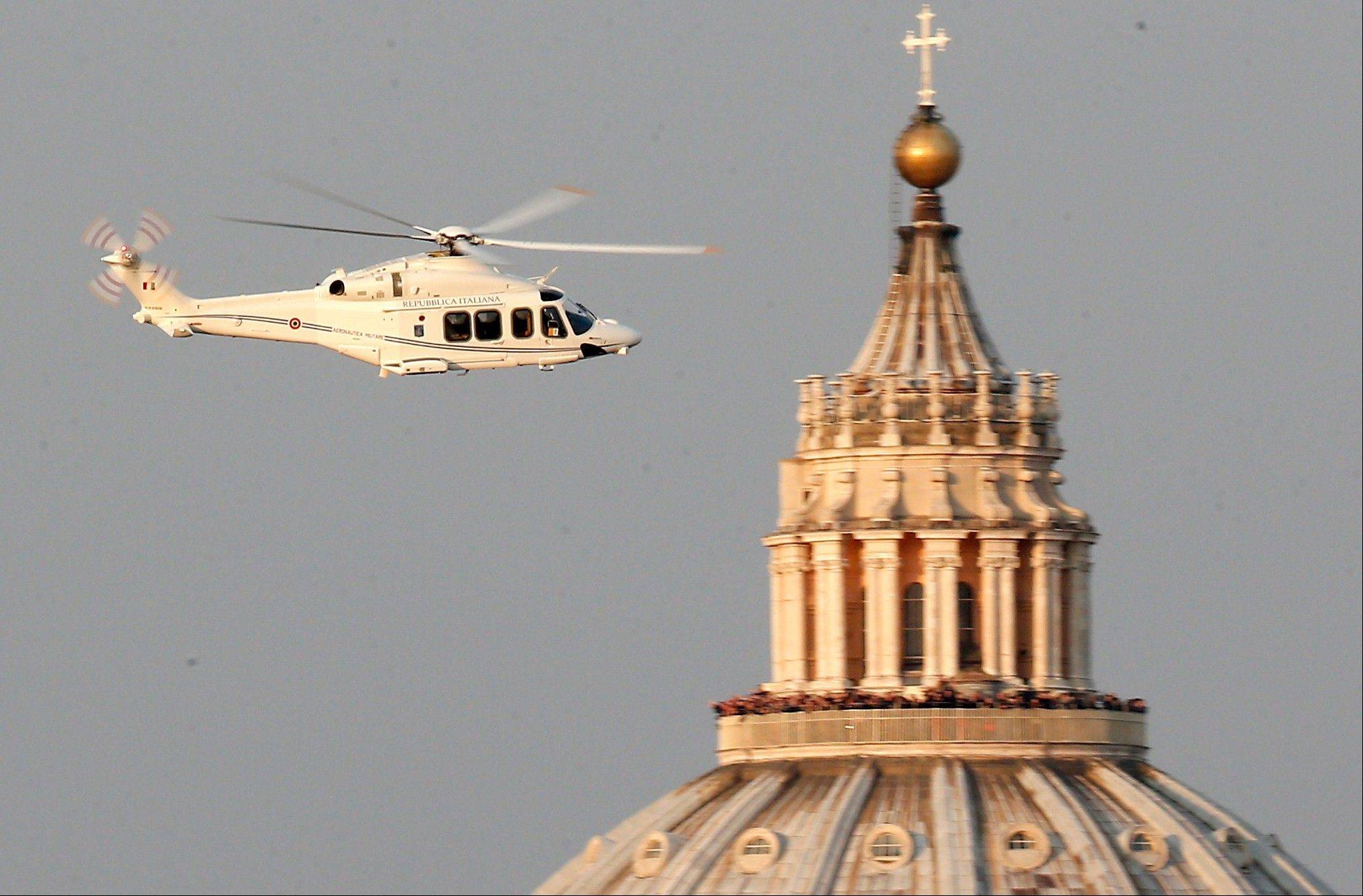 A helicopter with Pope Benedict XVI onboard Thursday leaves the Vatican in Rome. The 85-year-old German Pope Benedict is stepping down on Thursday evening, the first pope to do so in 600 years, after saying he no longer has the mental or physical strength to vigorously lead the world's 1.2 billion Catholics.