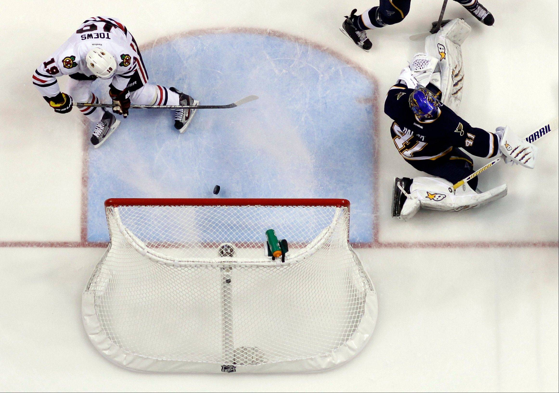 Chicago Blackhawks' Jonathan Toews scores past St. Louis Blues goalie Jaroslav Halak during the first period.