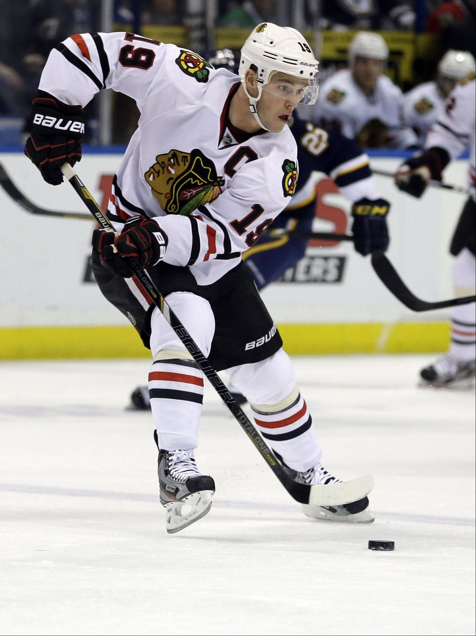 Chicago Blackhawks' Jonathan Toews handles the puck during the first period.