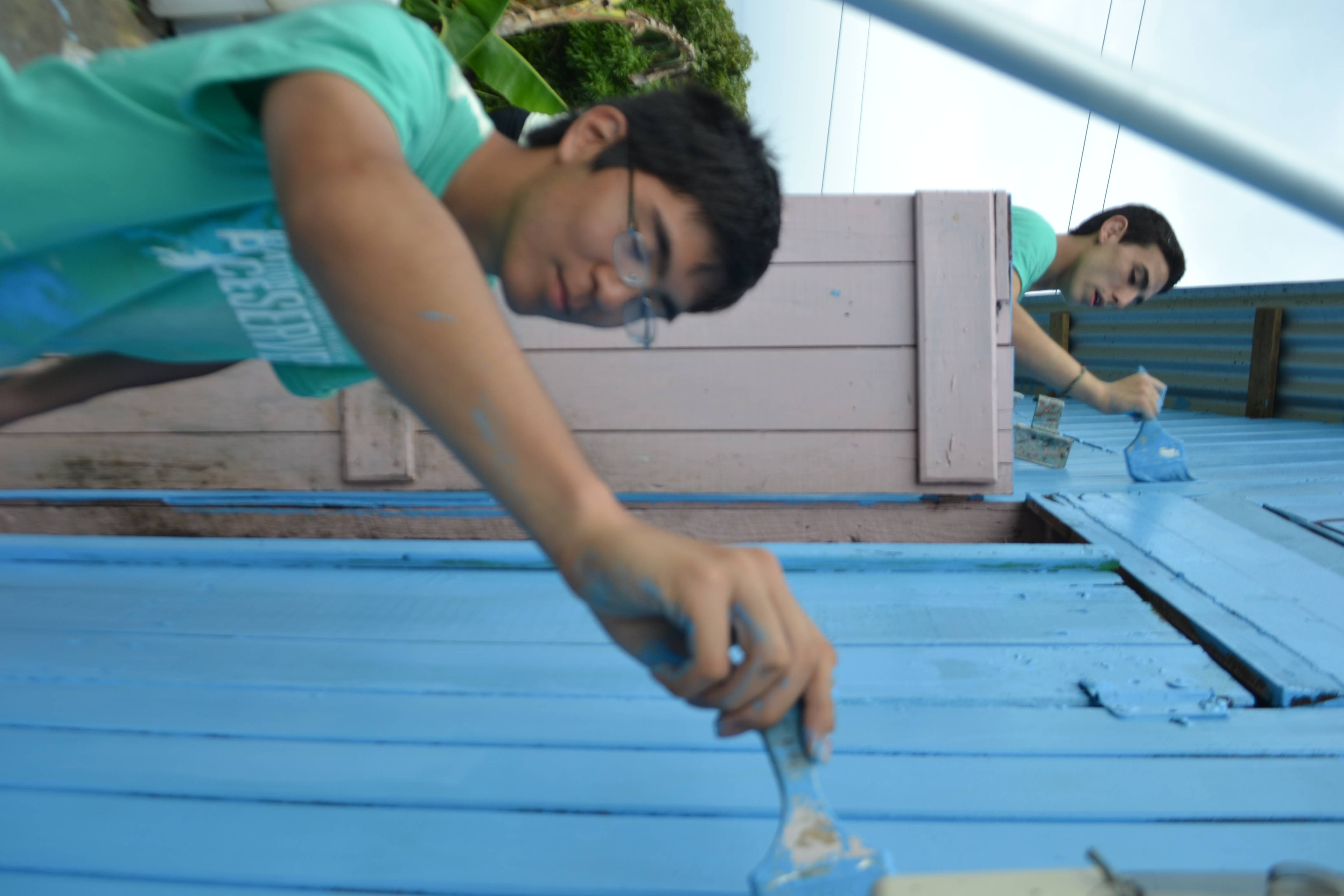 Kohsei painting a school in the community of St. Lucia