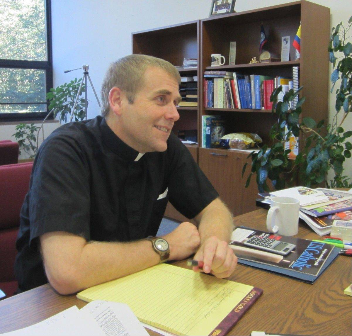 Fr. Corey Brost at his desk.