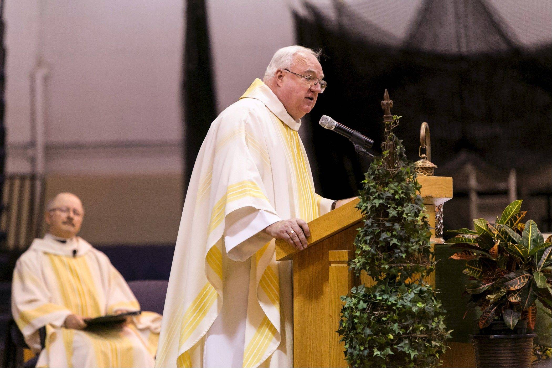 Father Robert Egan, outgoing president of St. Viator High School, saying Mass.