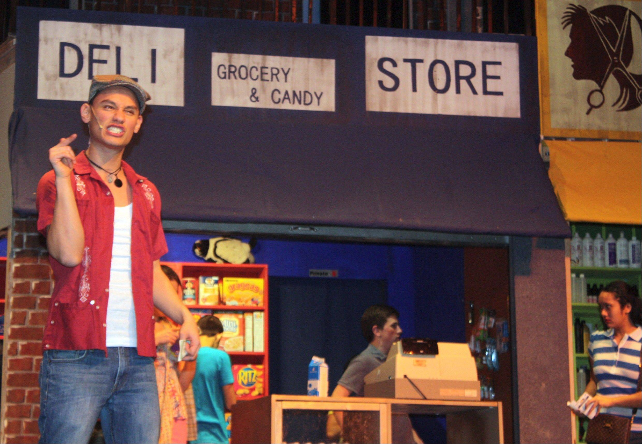 "Mynor Pelaez Luken onstage as Usnavi in the musical ""In the Heights."" The character Usnavi got his name after one of the first sights his parents saw when they arrived in America from the Dominican Republic, a U.S. Navy ship."