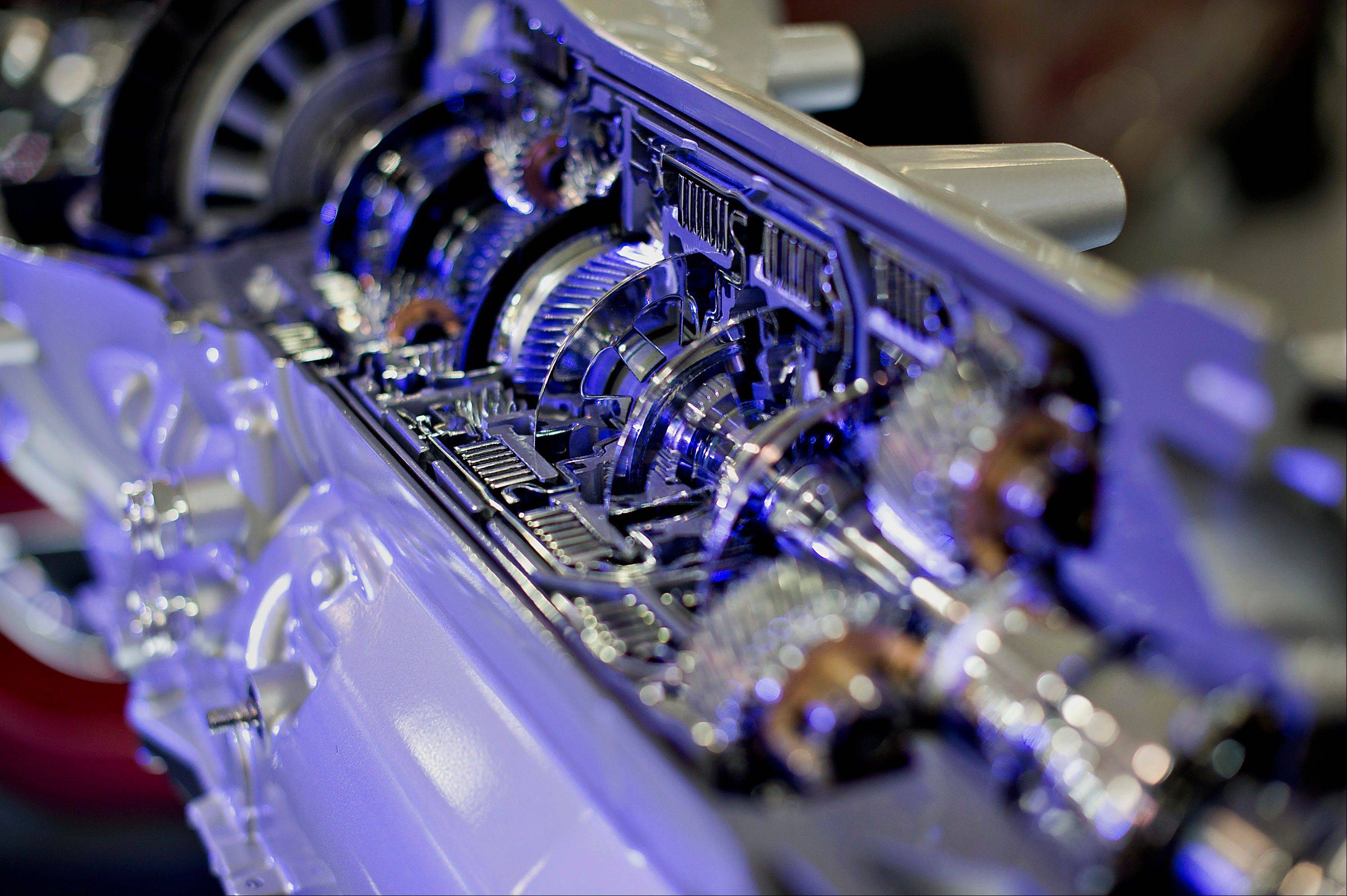 A cut-away version of a Chrysler eight-speed automatic transmission sits on display Thursday at the Chrysler Group transmission plant in Kokomo, Ind. Chrysler Group LLC will invest about $374 million and add 1,250 jobs at Indiana factories to boost output of eight-and nine-speed transmissions.