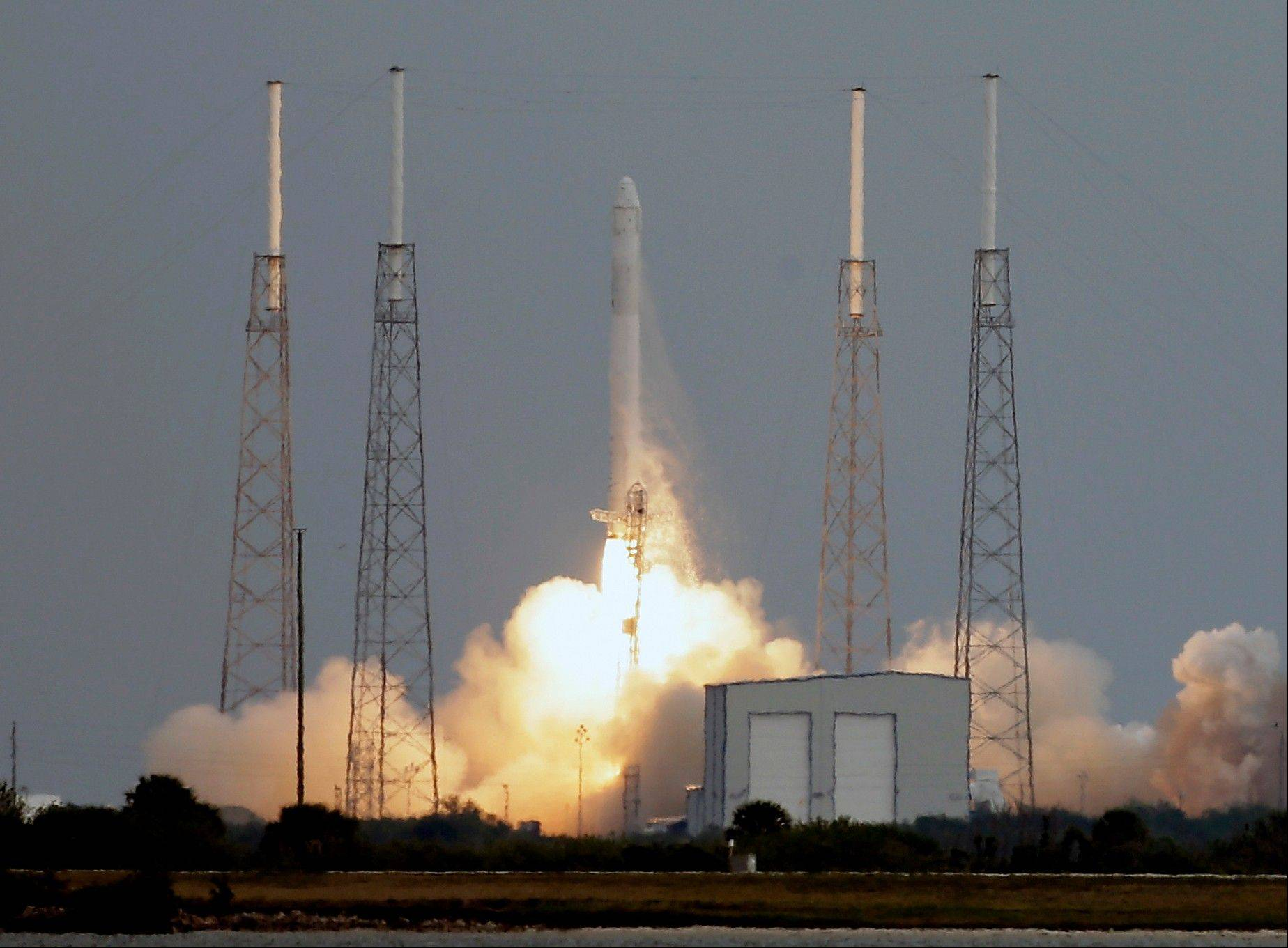 The Falcon 9 SpaceX rocket lifts off Friday from launch complex 40 at the Cape Canaveral Air Force Station in Cape Canaveral, Fla.