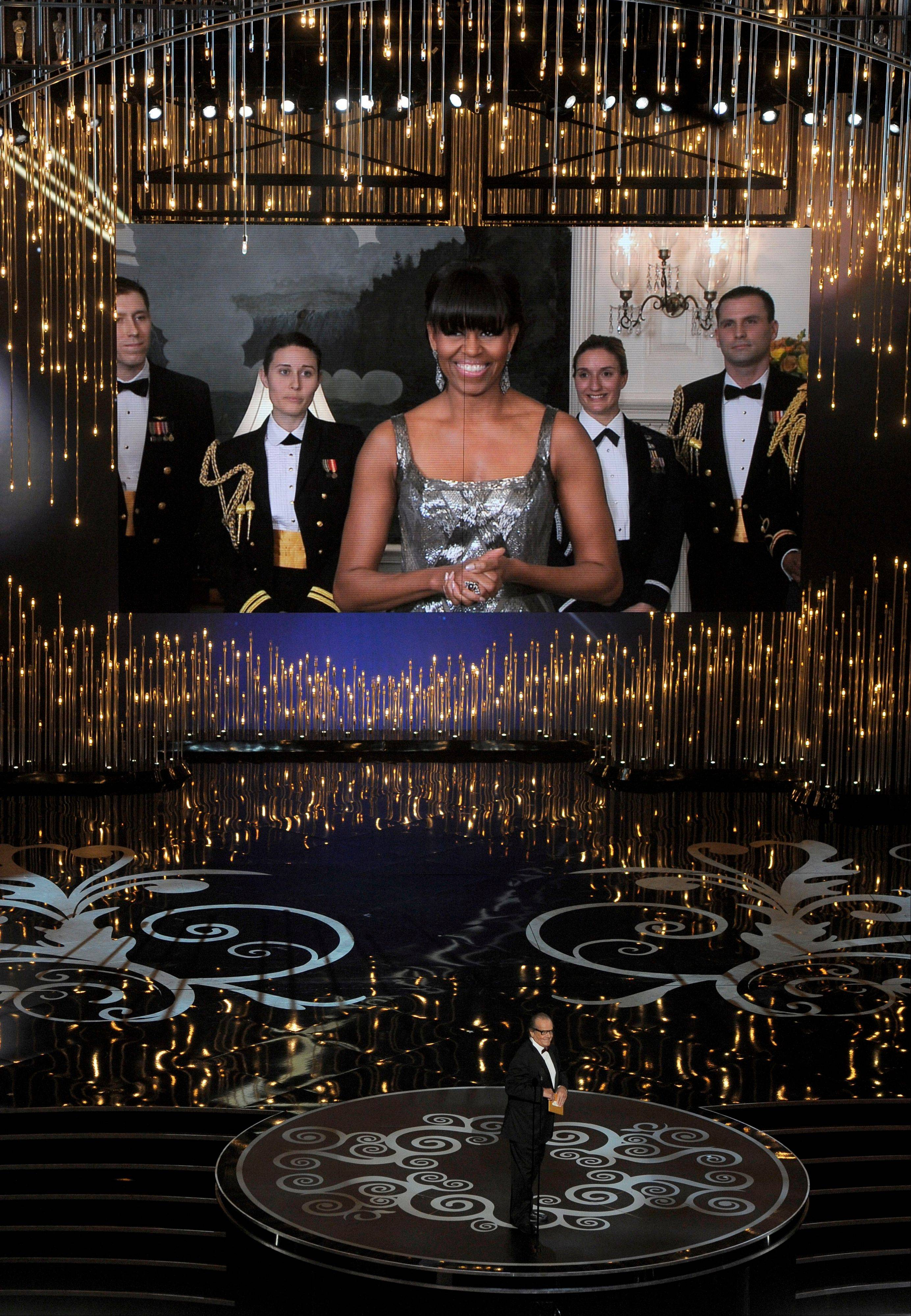 First lady Michelle Obama appeared on screen during the Oscars Sunday, while actor Jack Nicholson presented the award for best picture.