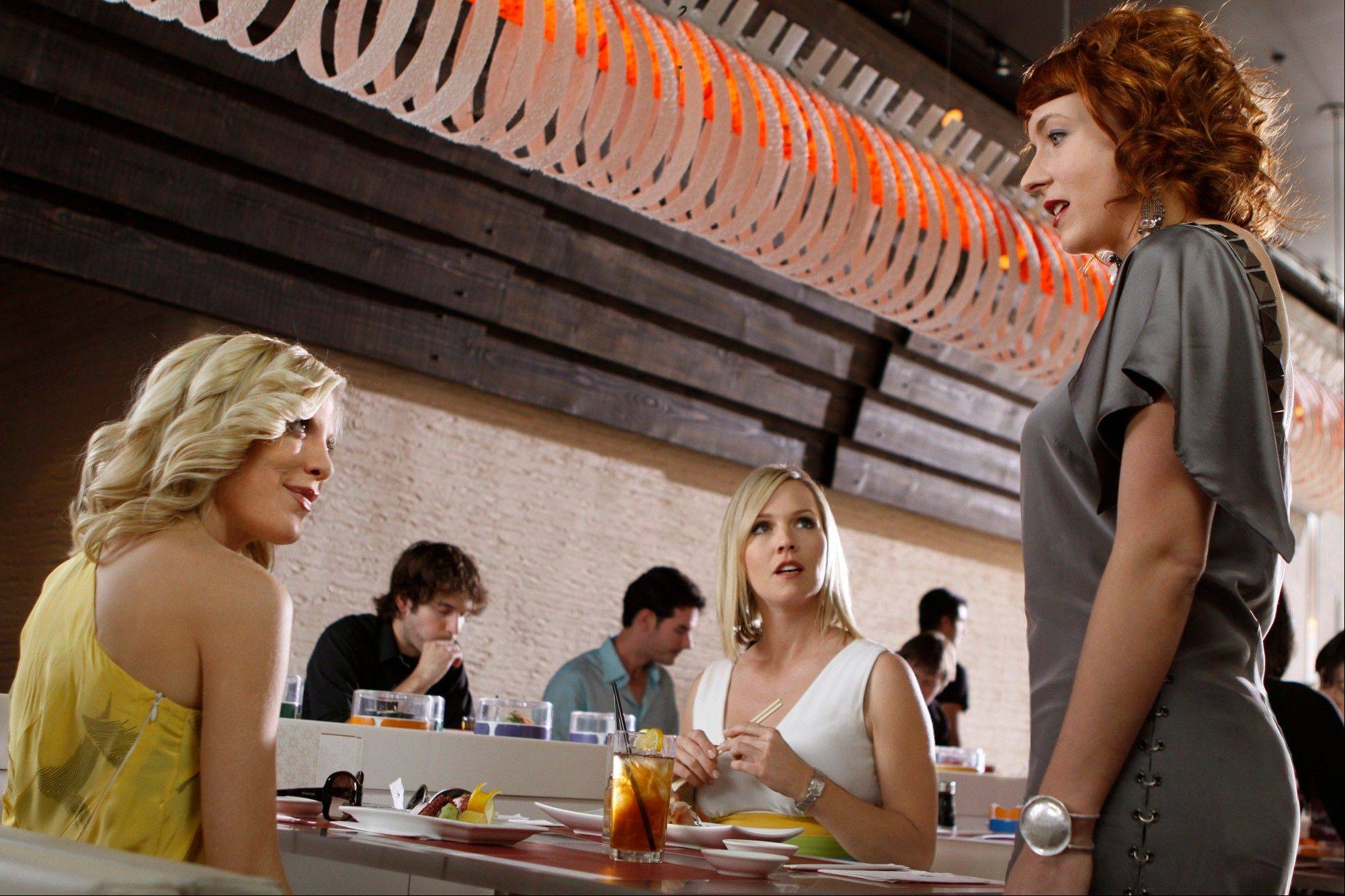 Tori Spelling, left, Jennie Garth and Diablo Cody are shown in a scene from �90210.� The CW network announced Thursday that the show will wrap in May after five seasons.