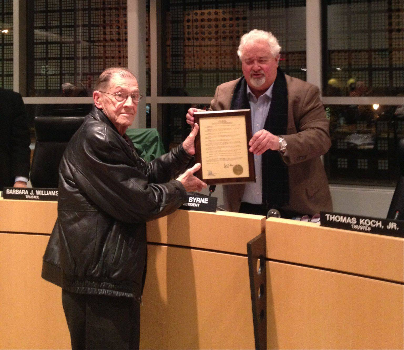 Ed Sychta, left, receives a proclamation from Vernon Hills Mayor Roger Byrne at a recent board meeting honoring his years of service to the Vernon Hills Seniors Organization.