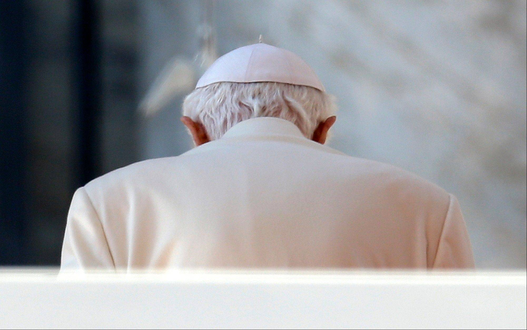 Pope Benedict XVI leaves after celebrating his final general audience in St. Peter's Square Wednesday at the Vatican. Cardinals will begin meeting Monday to set the date for the conclave to elect the next pope.