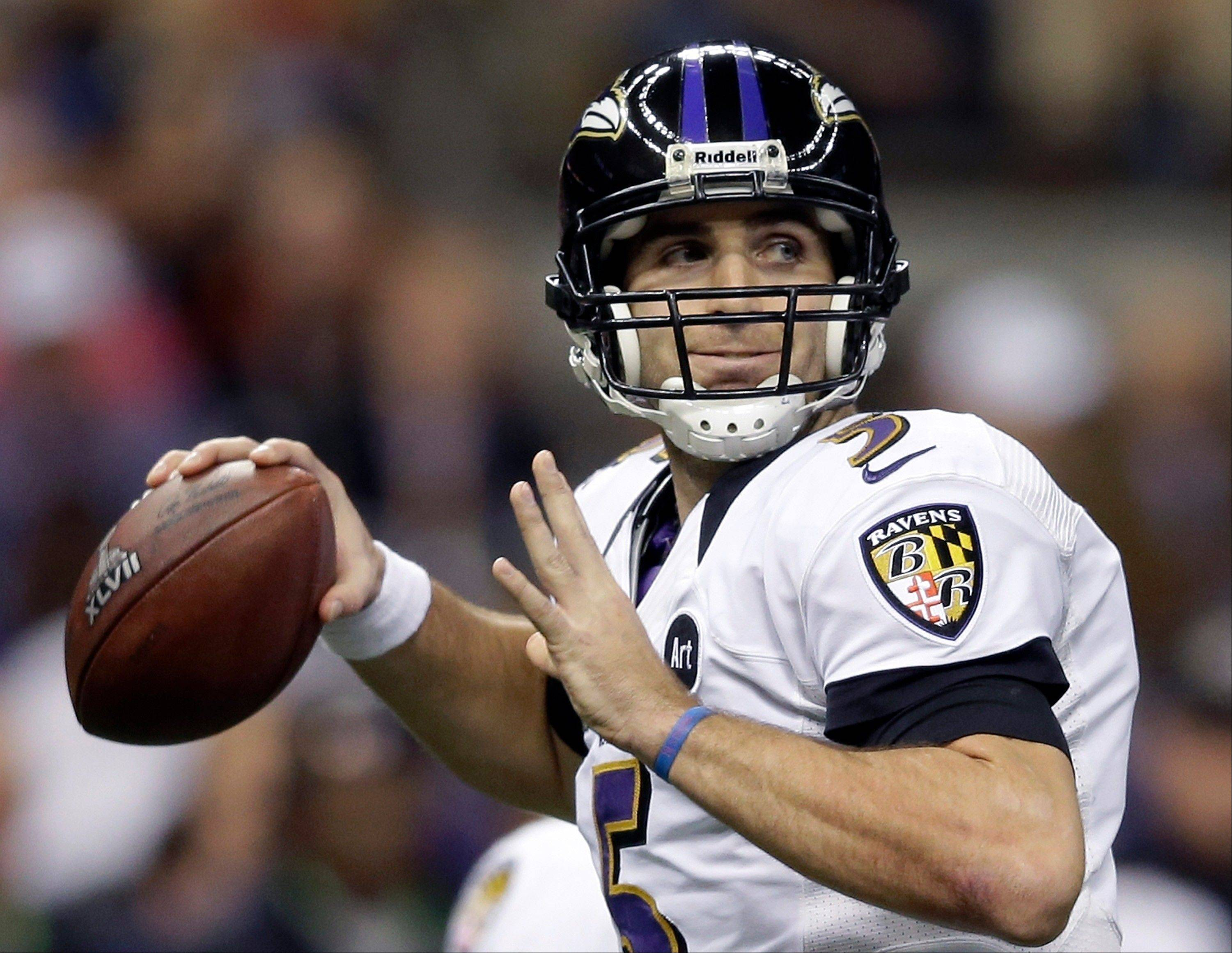 FILE - In this Feb. 3, 2013, file phot, Baltimore Ravens quarterback Joe Flacco (5) looks to throw a pass during the first half of the NFL Super Bowl XLVII football game against the San Francisco 49ers in New Orleans. A person with knowledge of the deal tells The Associated Press that Flacco has agreed on a new contract with the Ravens. The person spoke on condition of anonymity on Friday, March 1, 2013, because the agreement has not officially been announced. Terms of the deal were not immediately available. (AP Photo/Evan Vucci, FIle)