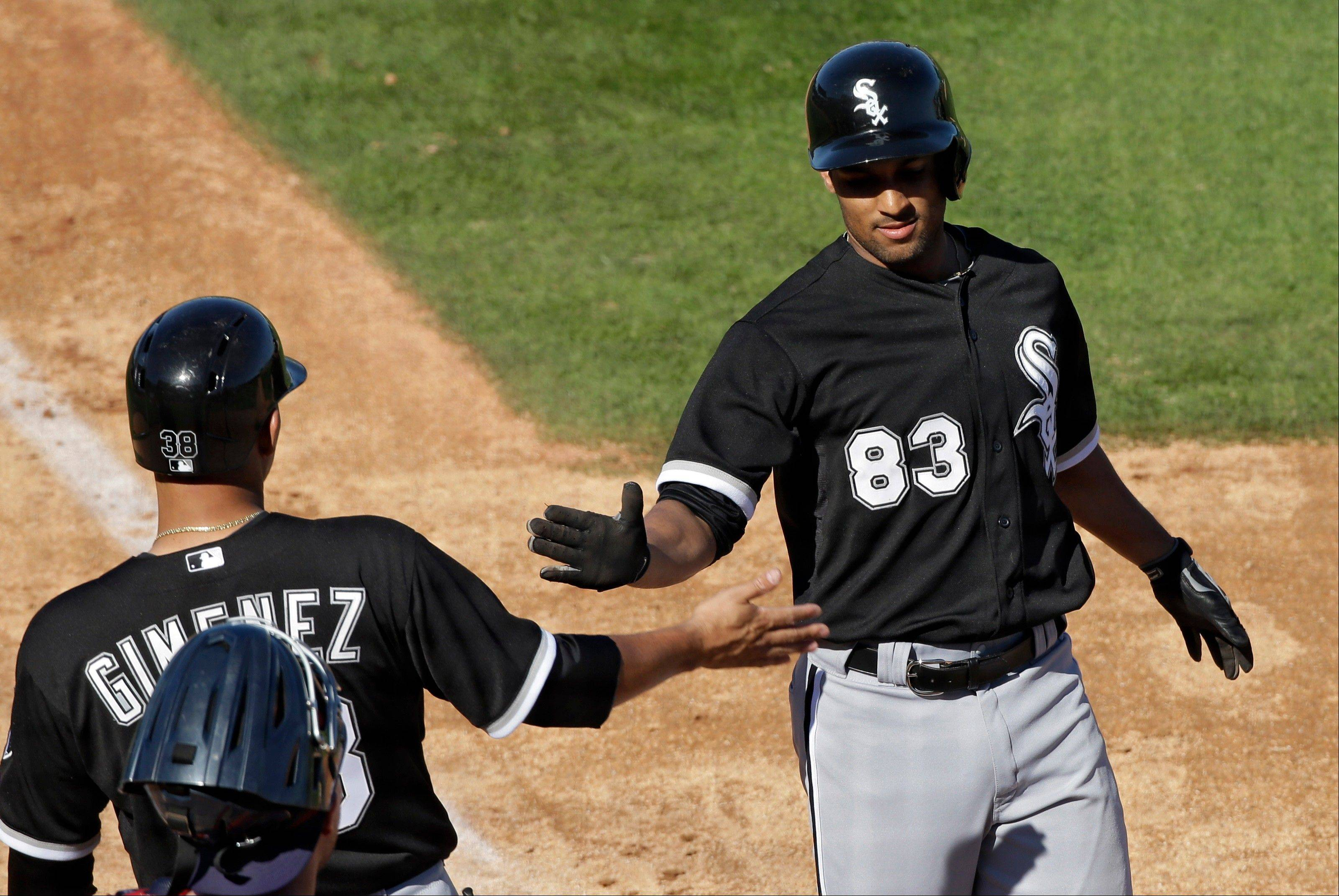 Chicago White Sox's Marcus Semien (83) is greeted at home by Hector Gimenez after hitting a 3-run home run off Cleveland Indians relief pitcher David Huff in the sixth inning of an exhibition spring training baseball game Friday, March 1, 2013, in Goodyear, Ariz. (AP Photo/Mark Duncan)