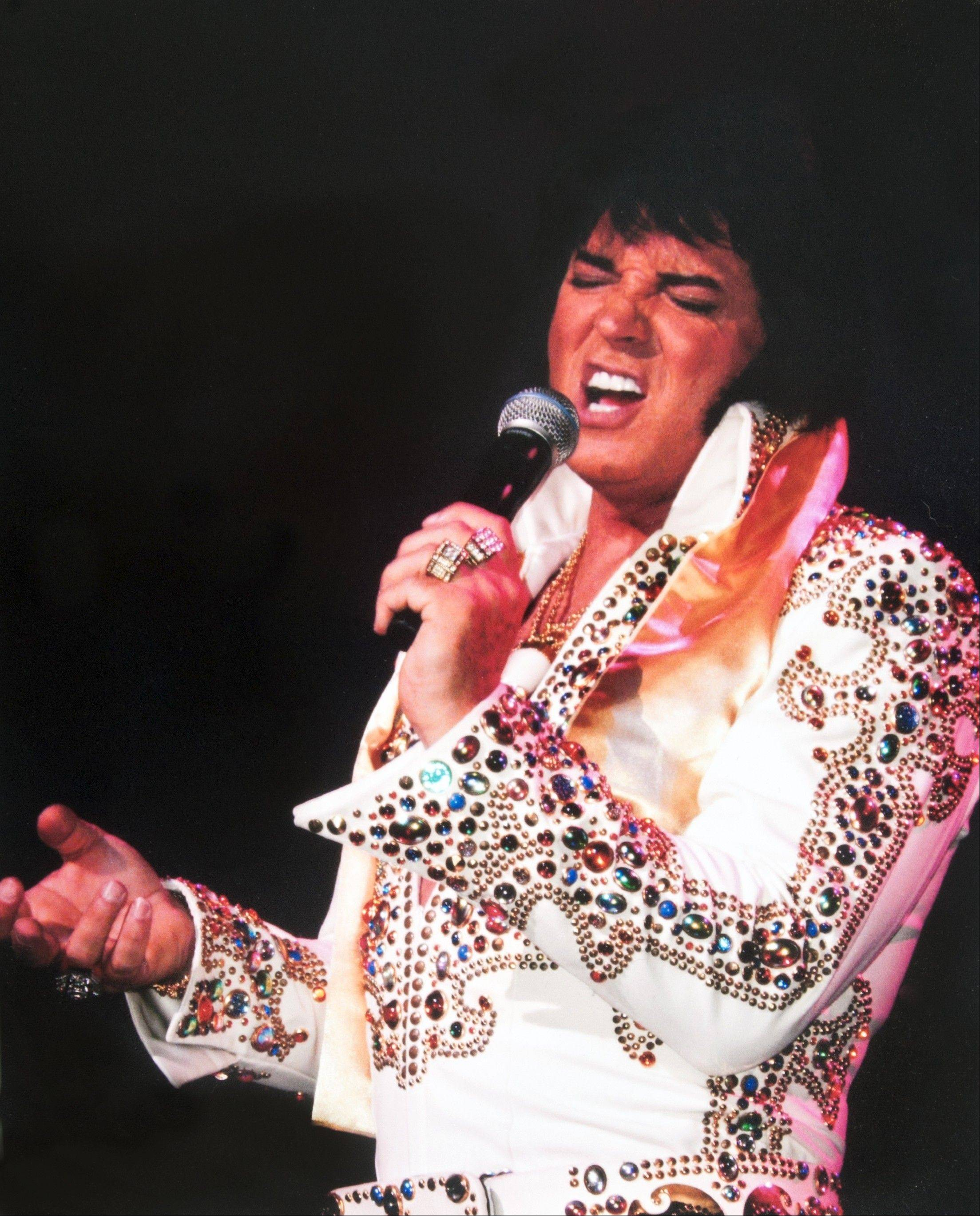 "Ultimate Elvis Tribute Artist Contest winner Bill Cherry performs along with other finalists in ""Elvis Lives"" at the Akoo Theatre in Rosemont."