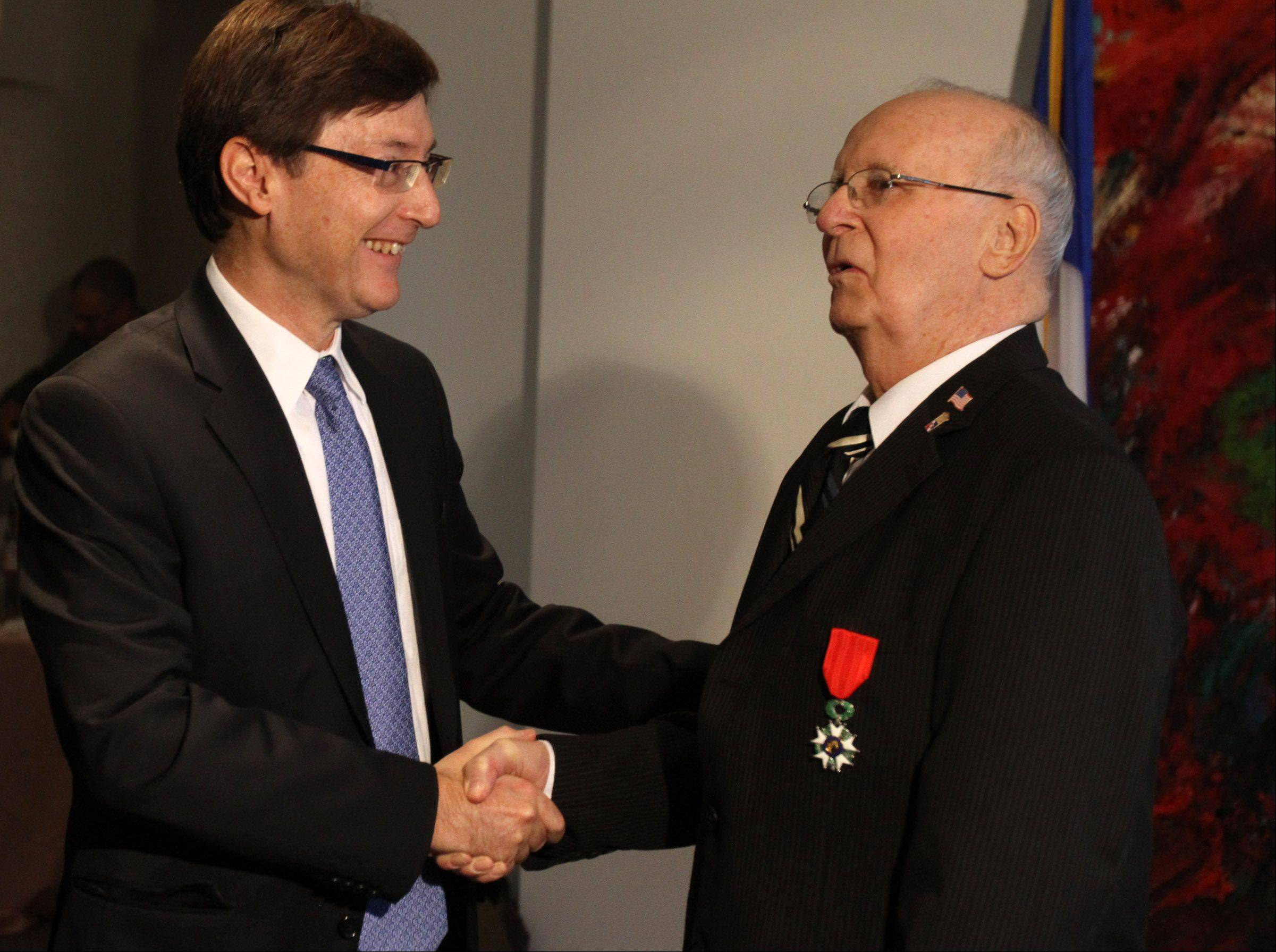 Jim Butz of Schaumburg receives the French Legion of Honor medal from Consul Graham Paul at the Consulate General of France in Chicago on Friday. He was honored for his service in liberating France on D-Day and in the Battle of the Bulge.