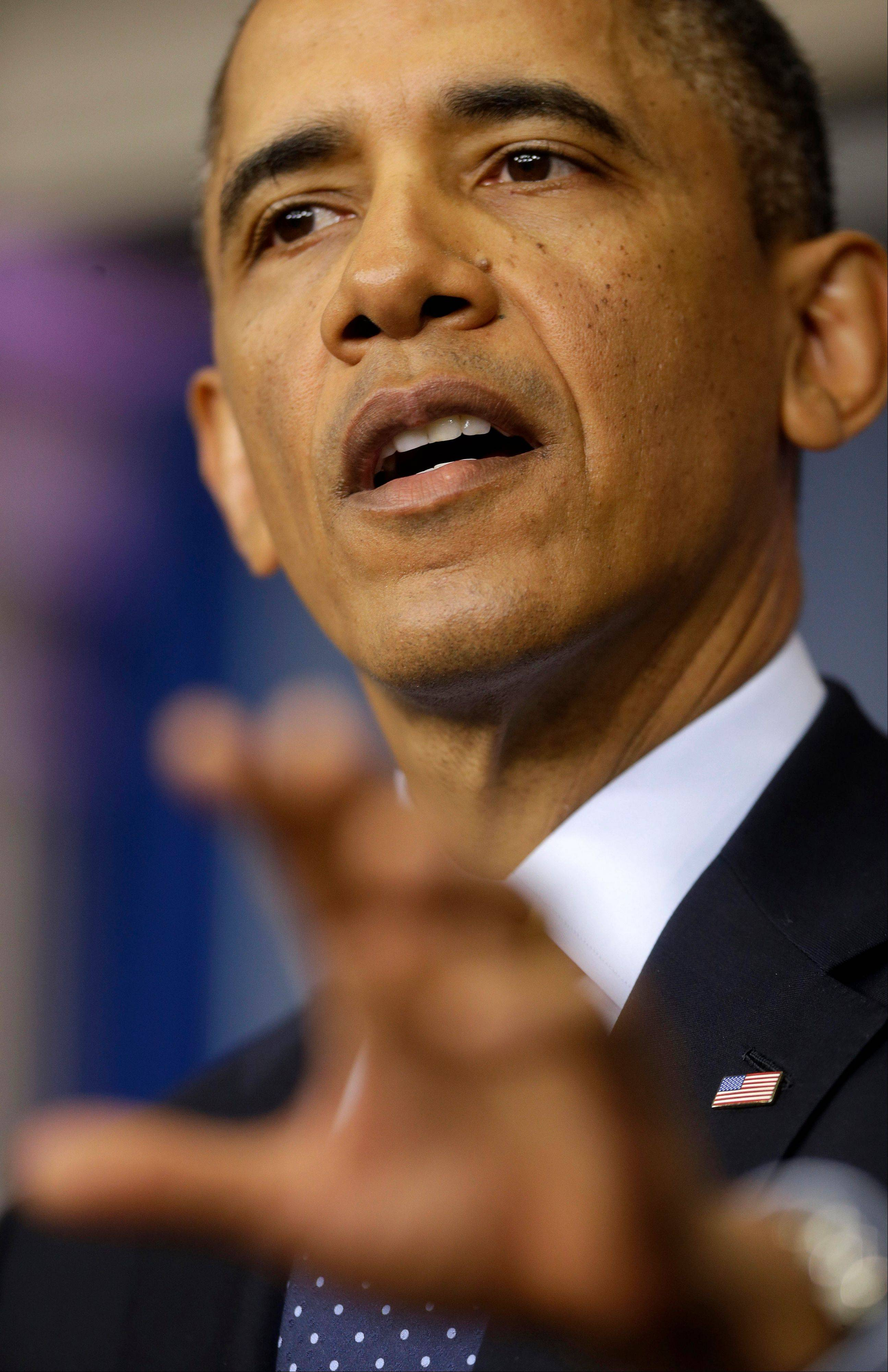President Barack Obama speaks to reporters Friday.