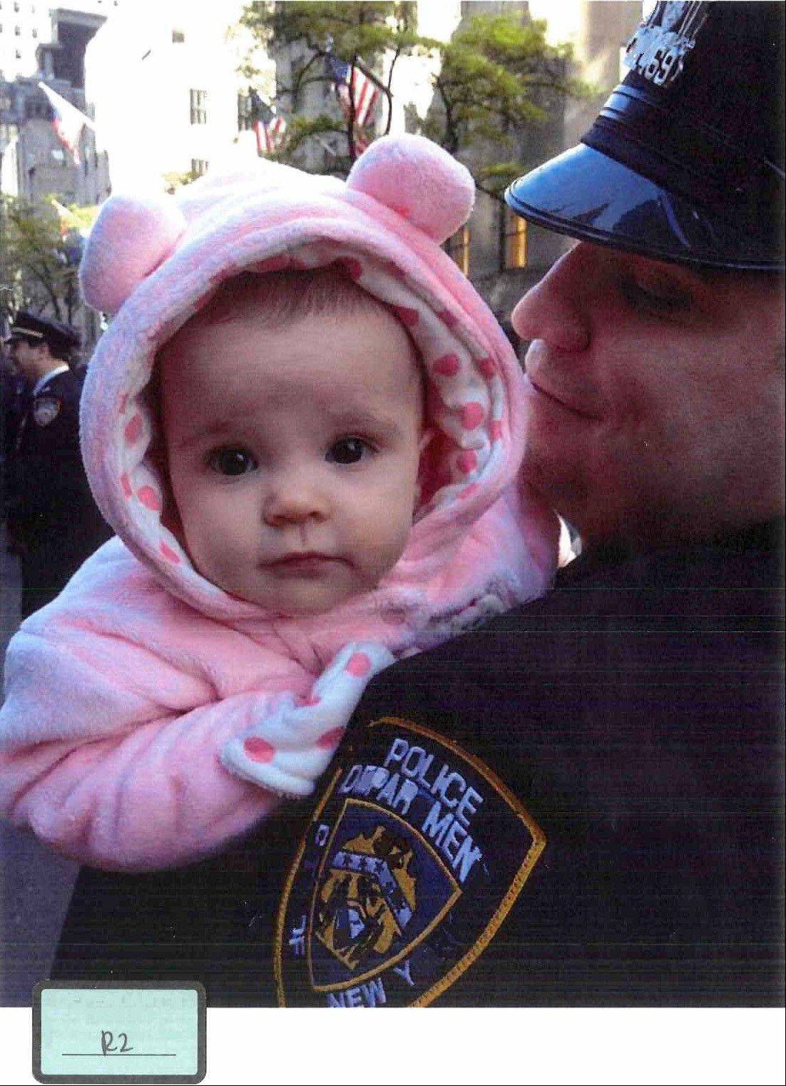 This undated photo submitted into evidence by Assistant Federal Defender Julia L. Gatto shows Gilberto Valle with his daughter.
