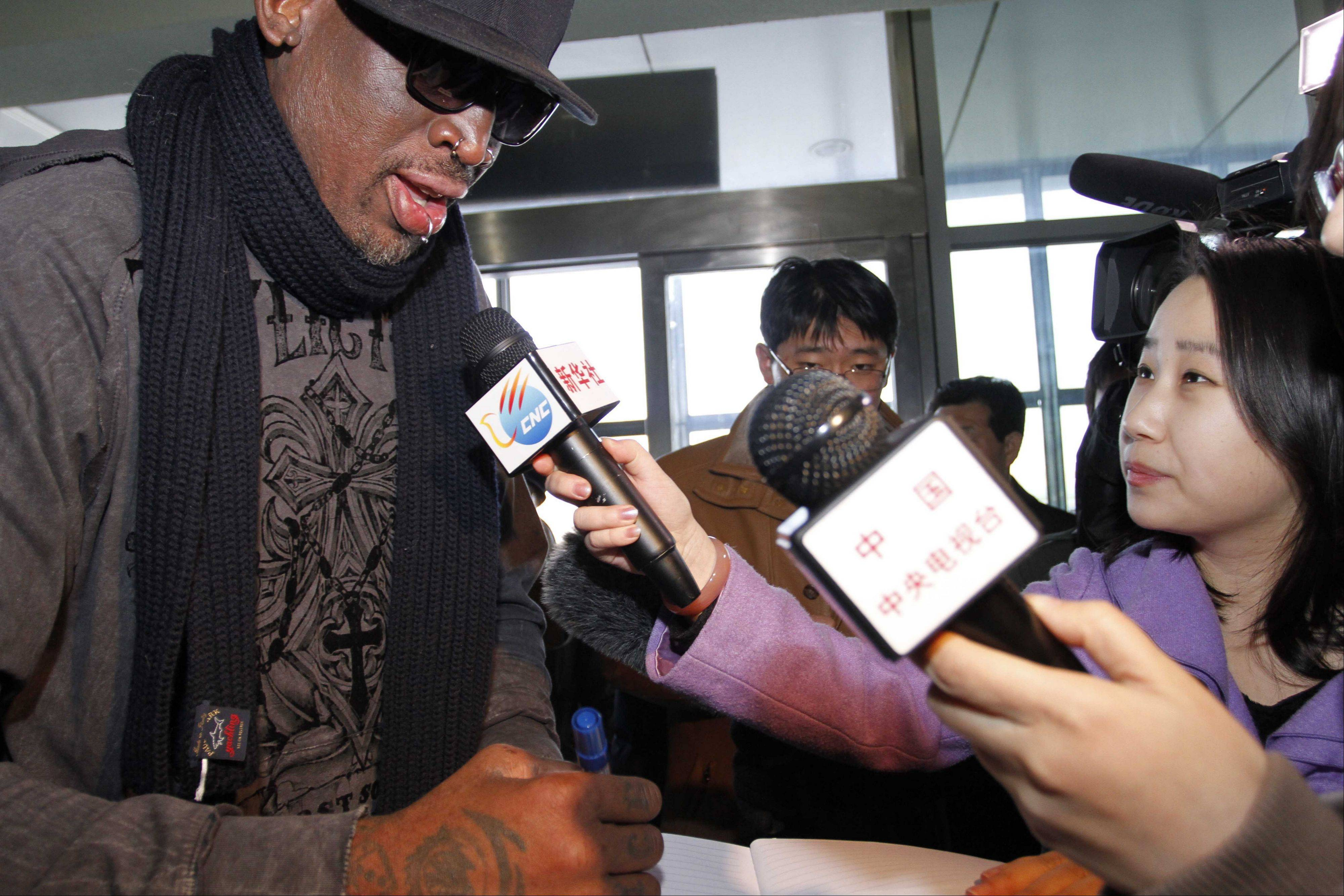 Former NBA star Dennis Rodman speaks to the media Friday at the airport in Pyongyang, before he leaves North Korea. Rodman hung out with North Korea's Kim Jong Un during his improbable journey to Pyongyang, watching the Harlem Globetrotters with the leader and later drinking and dining on sushi with him.