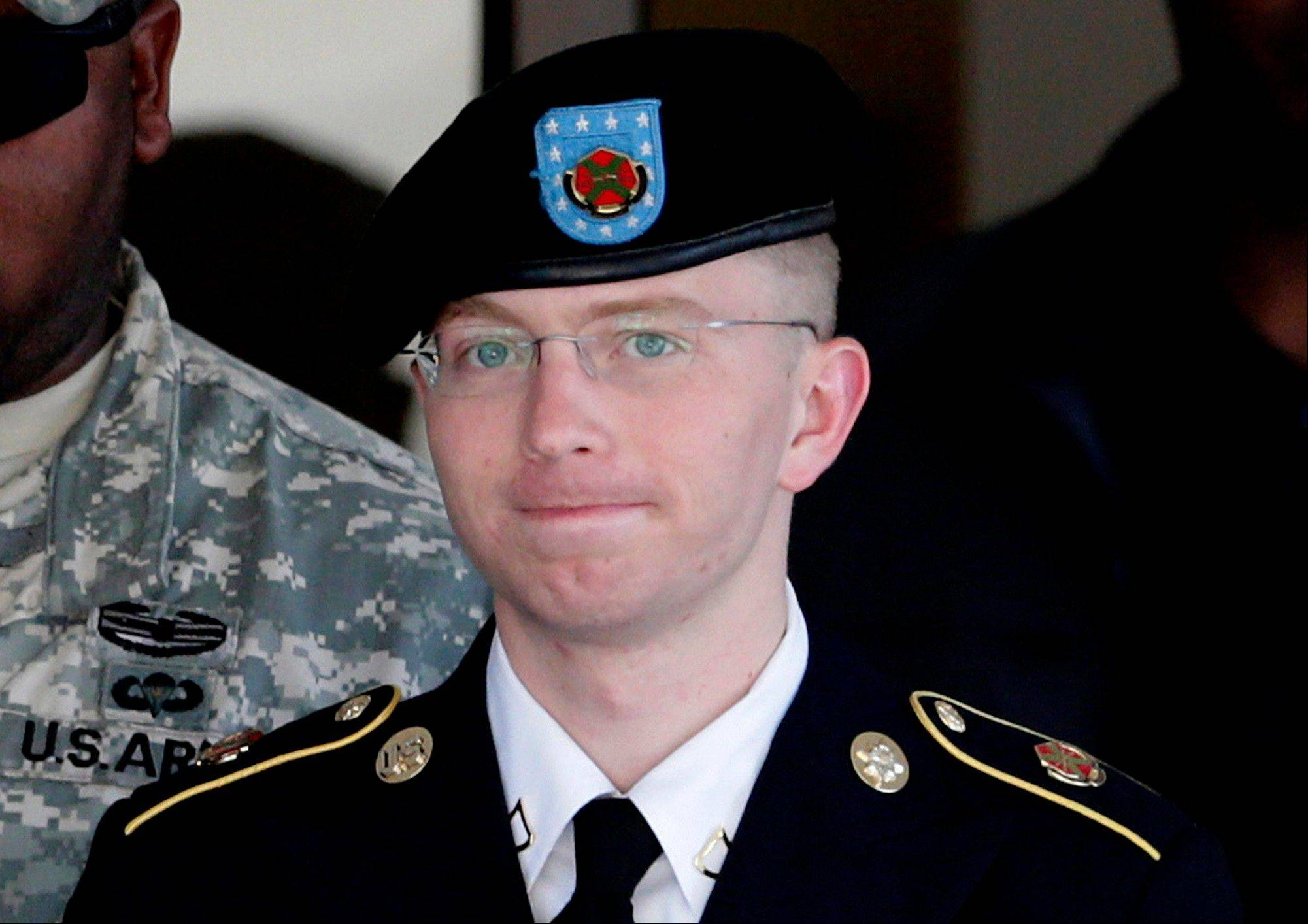 Army Pfc. Bradley Manning, right, is escorted out of a courthouse in Fort Meade, Md. The Army private charged in the largest leak of classified material in U.S. history said Thursday he sent the material to WikiLeaks to enlighten the public about American foreign and military policy.