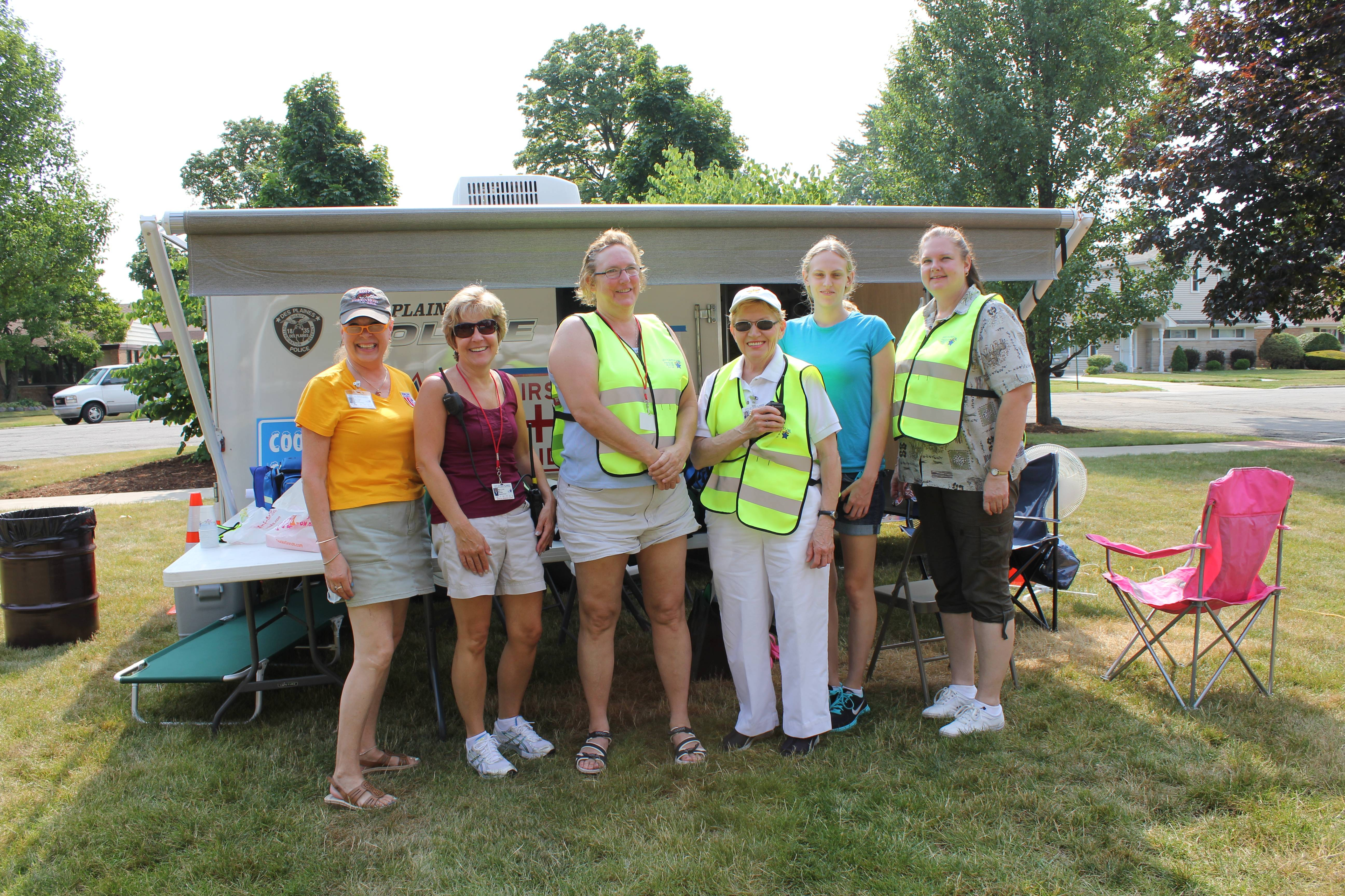 (pictured) Des Plaines Medical Reserve Corps registered nurses, Lynn Morgan, Mary Jo Coyne, Lisa Moore, Joanne Ross, Christina Moore (student nurse) and Terri Kaisling volunteer at the 2012 Tour De Villas Bike Race first aid station held in the fall.  The trailer that is pictured behind the nurses was made available through the National Association of County and City Health Officials (NACCHO). For additional information contact Community Health Nurse Madeline May at 847-391-5481.