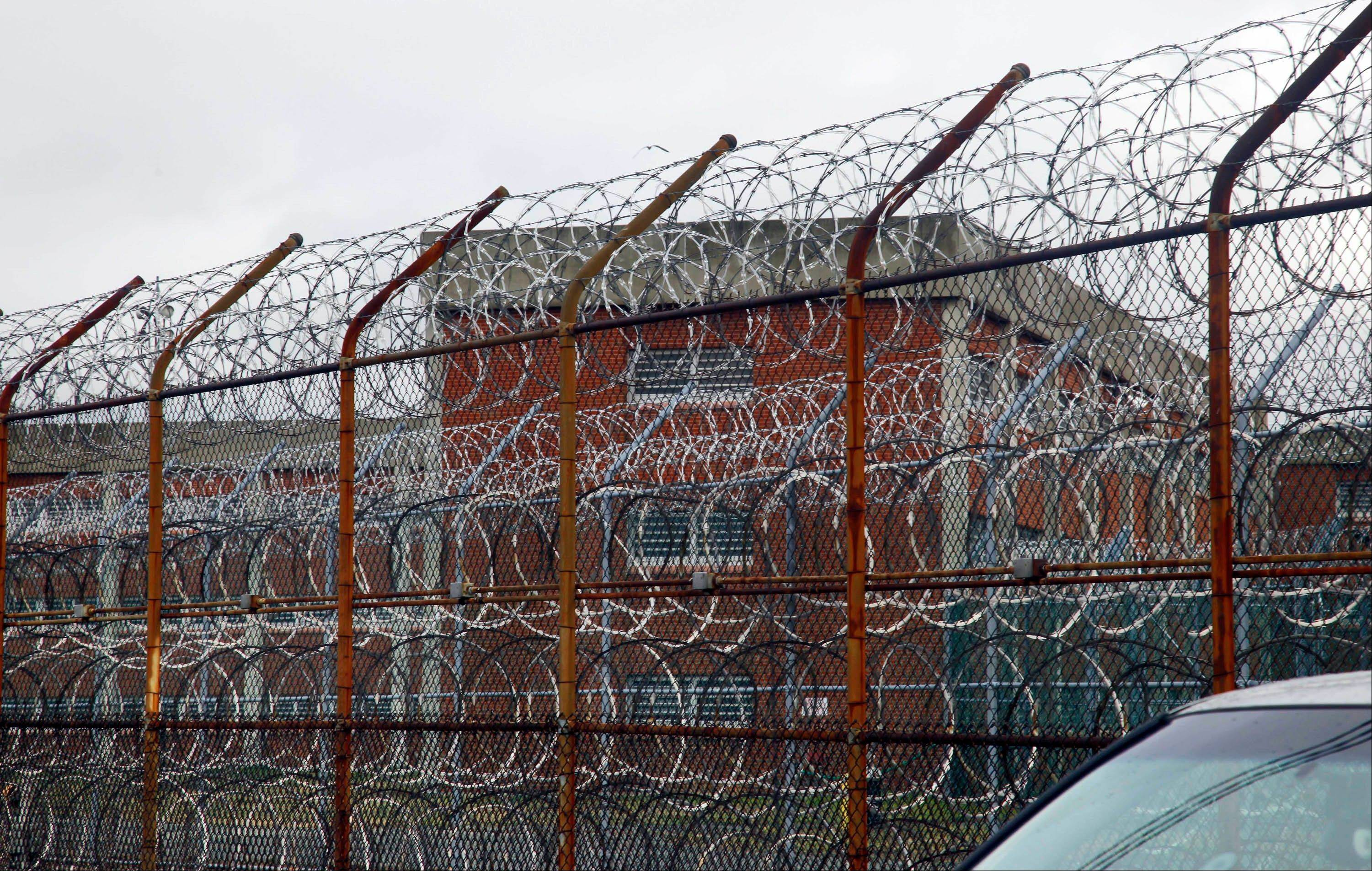 Associated Press/March 16, 2011 A barbed wire fence outside inmate housing on New York�s Rikers Island correctional facility in New York.