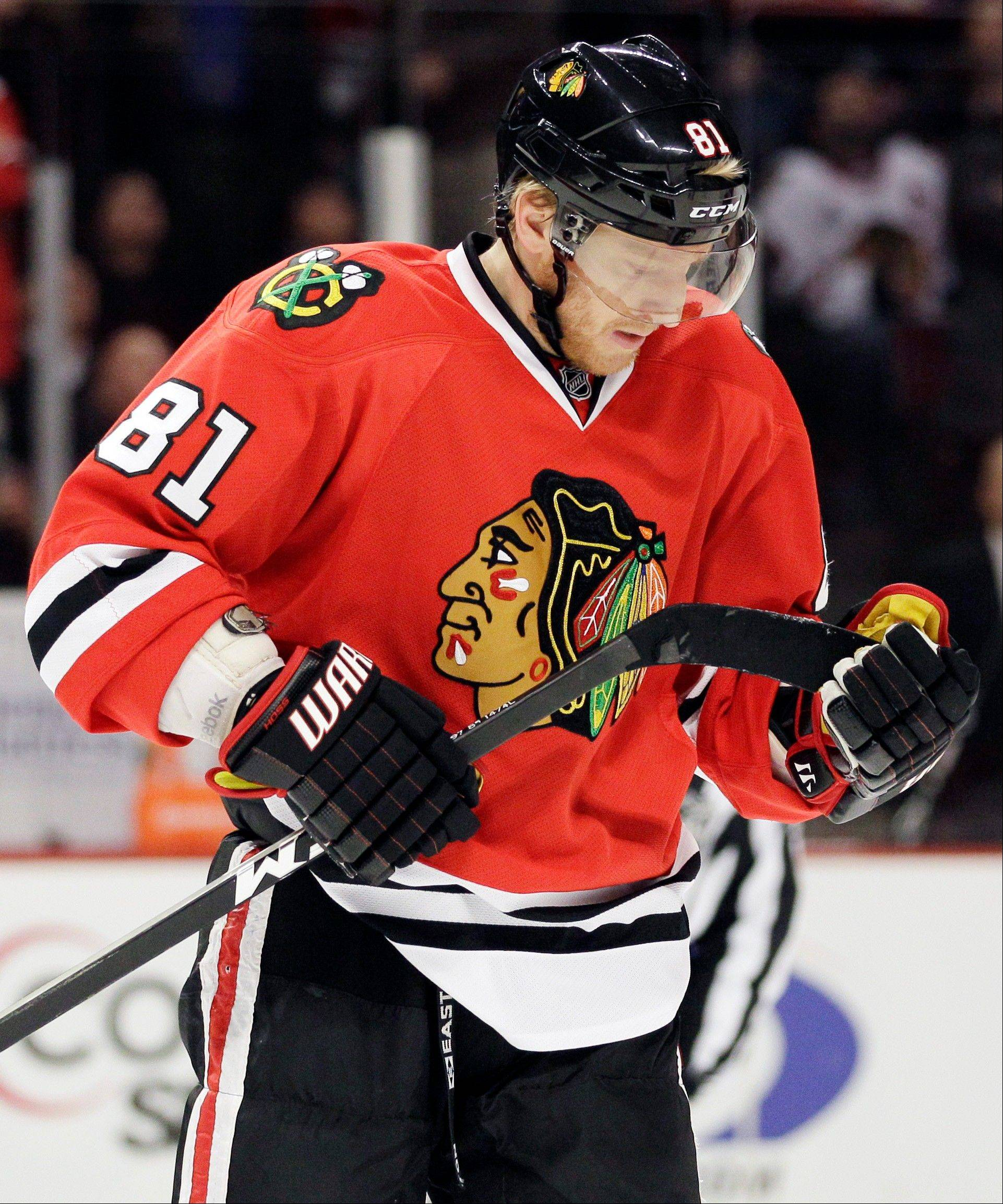 Hawks' Hossa proud to join 1,000-game club
